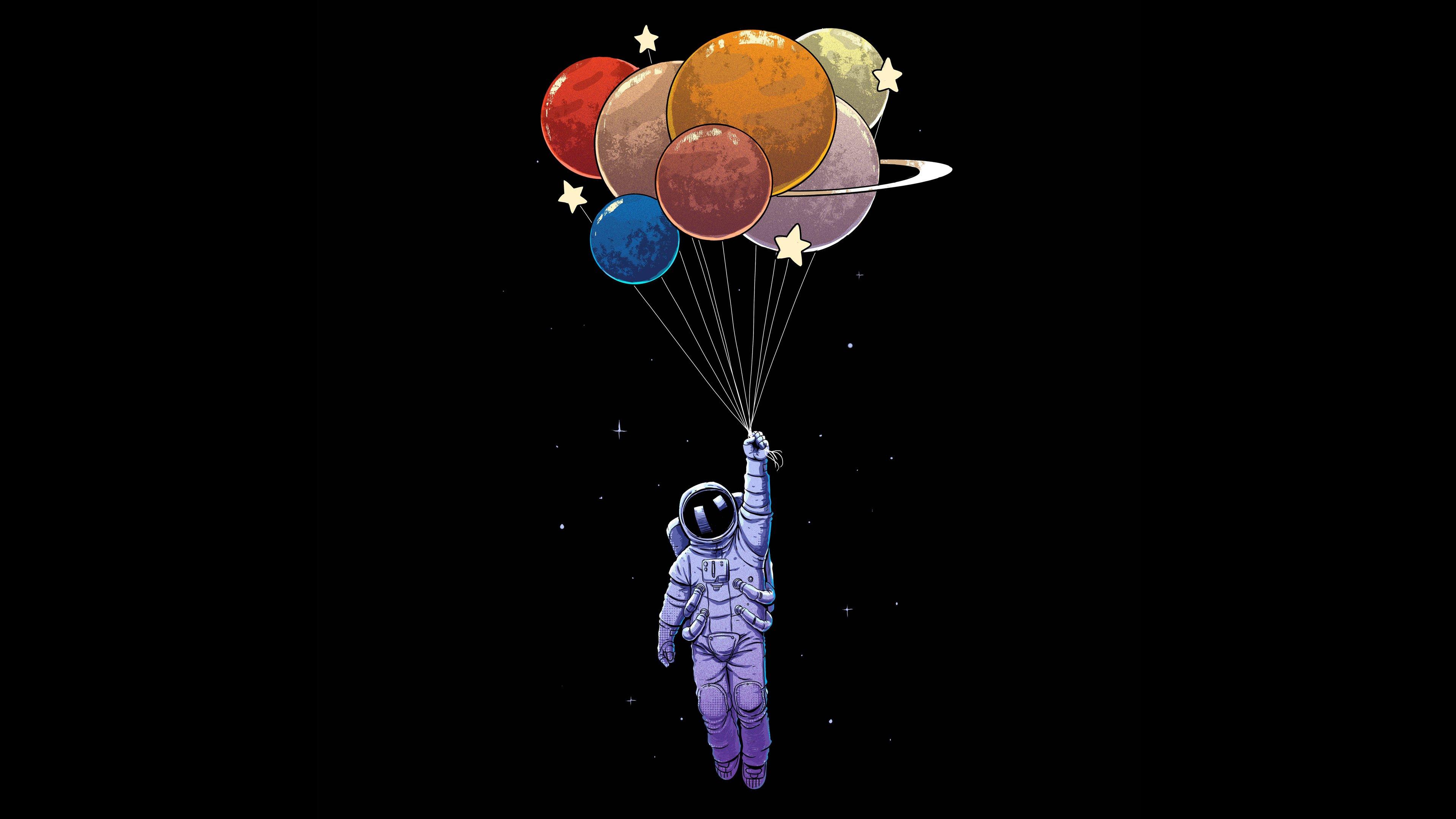 Fondos de pantalla Astronauta con globos como planetas