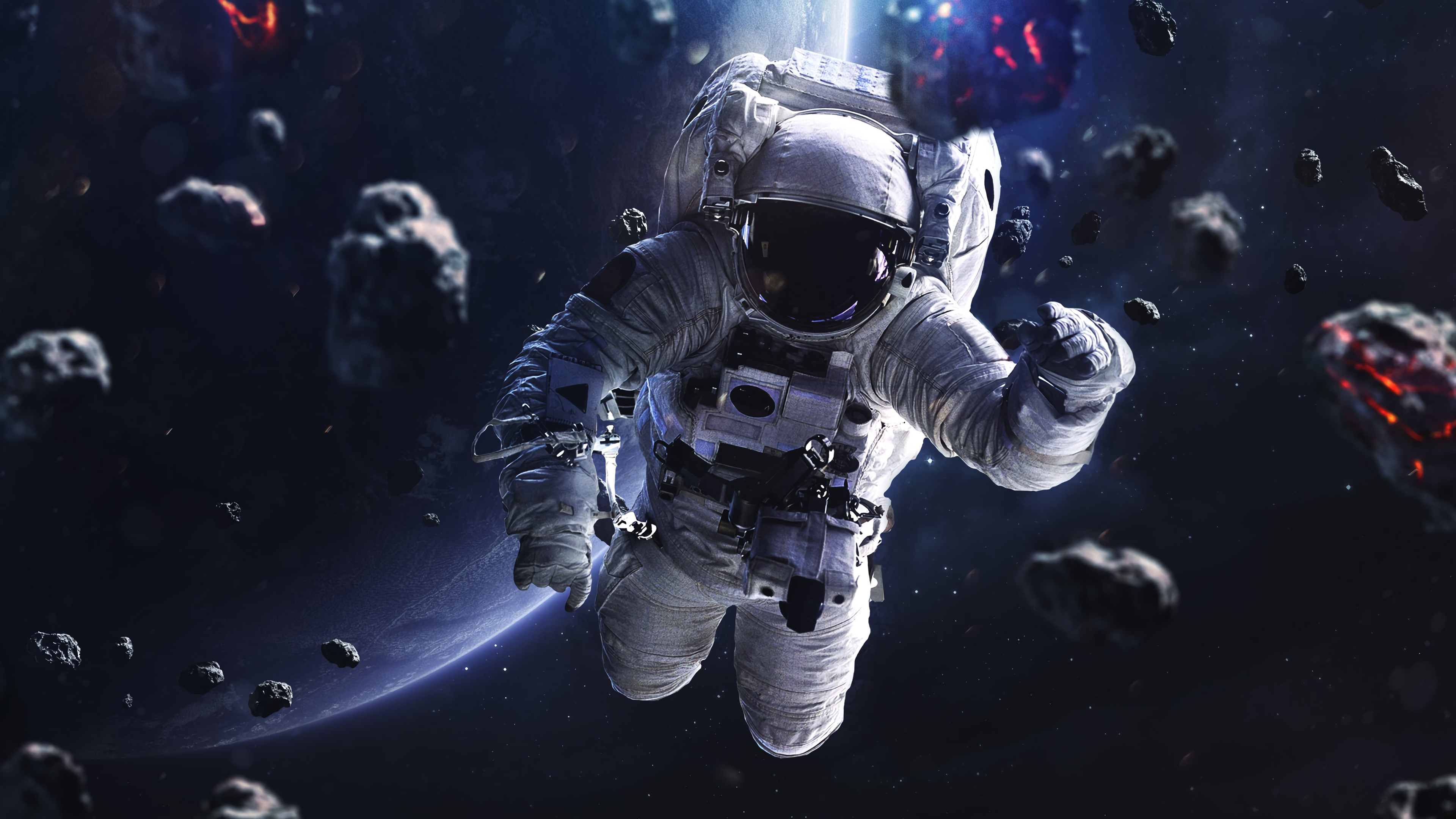 Fondos de pantalla Astronauta flotando alrededor de asteroides