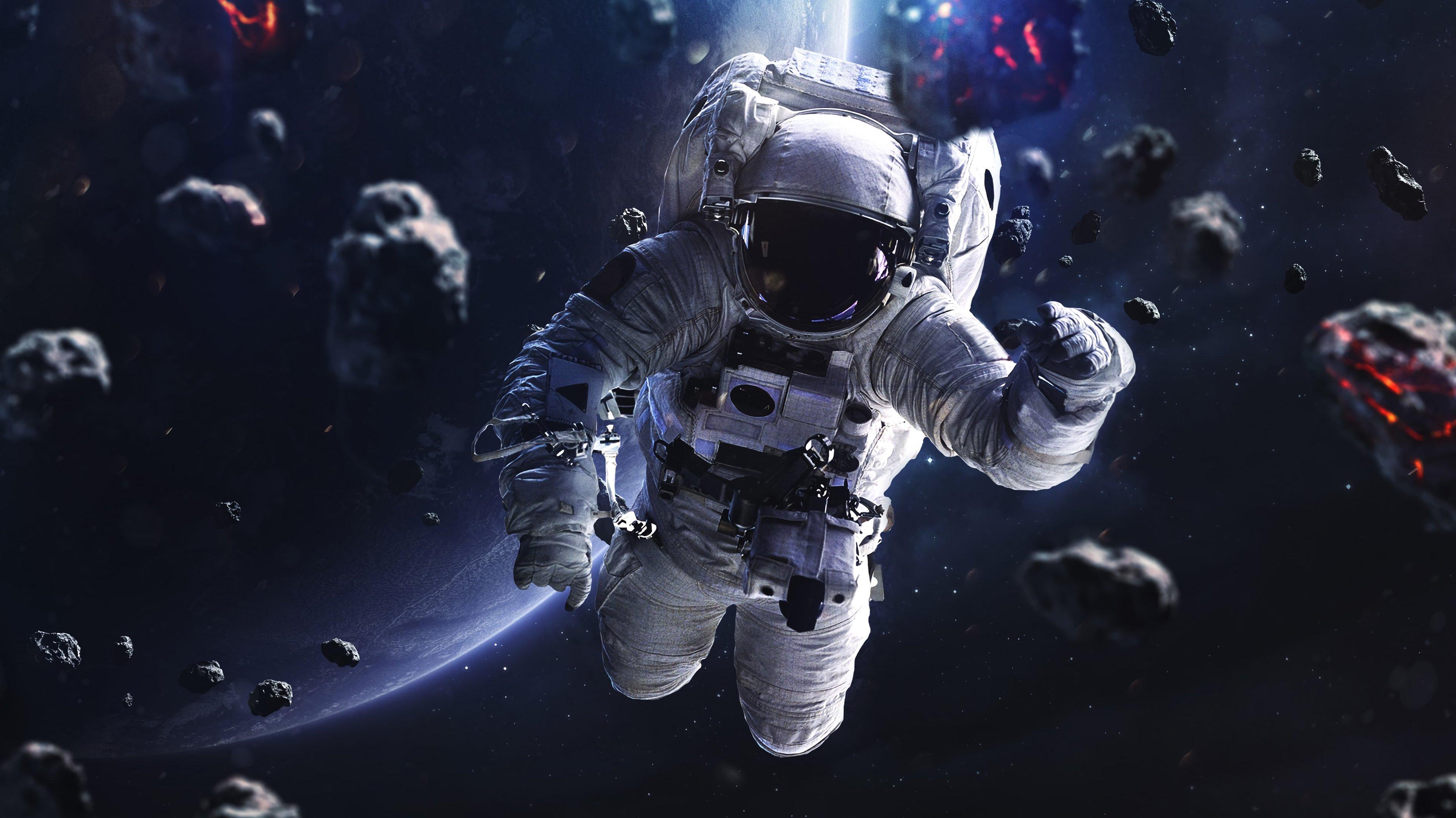 Wallpaper Astronaut floating around asteroids