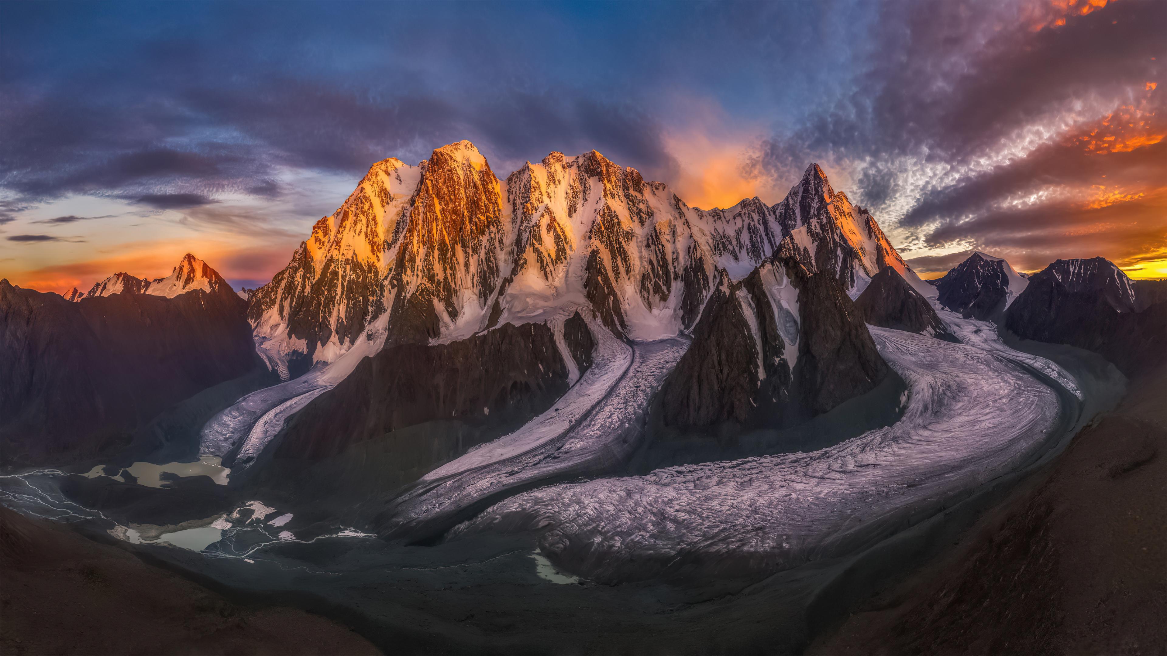 Fondos de pantalla Atardecer detras de montañas con nieve