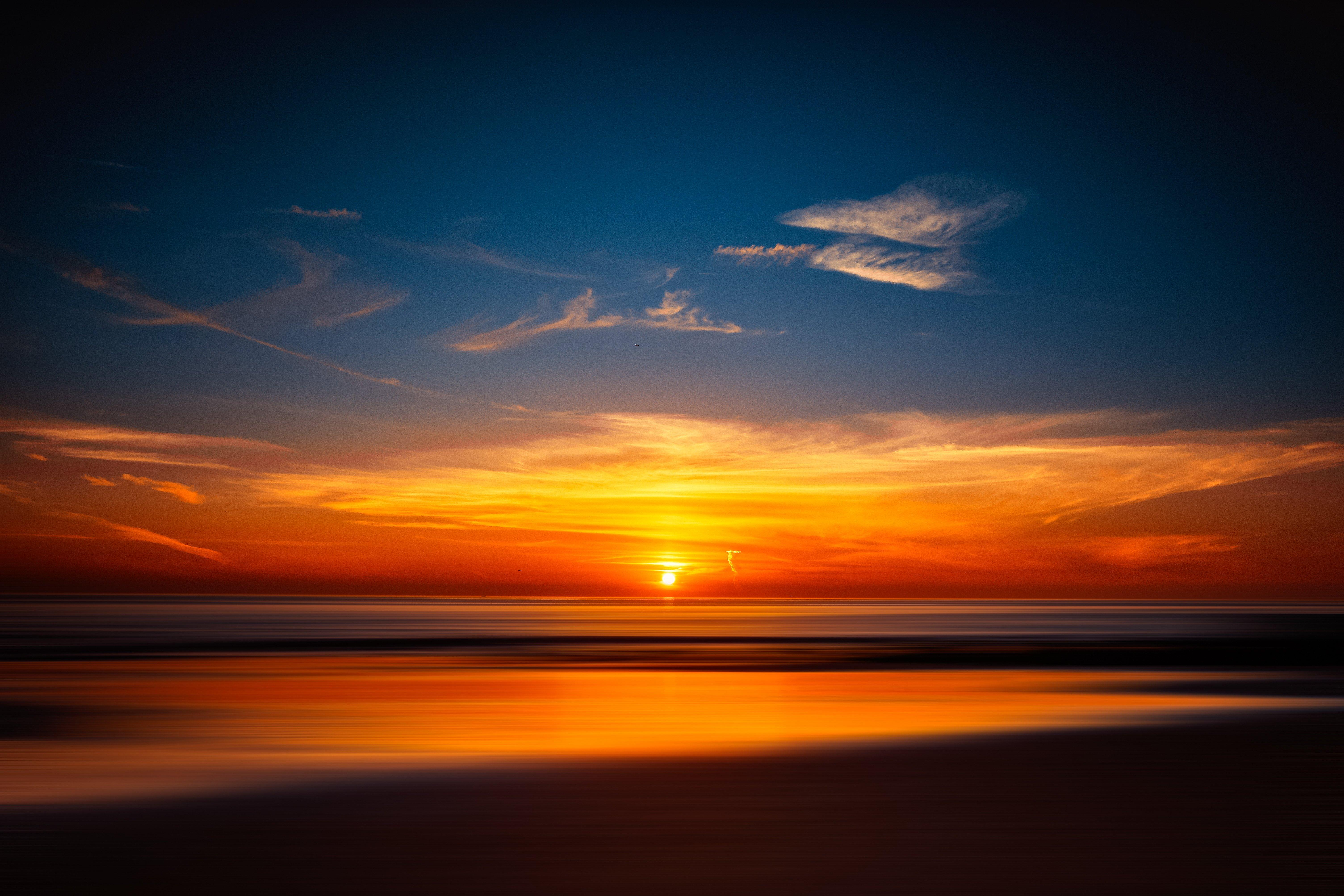 Fondos de pantalla Atardecer naranja en la playa