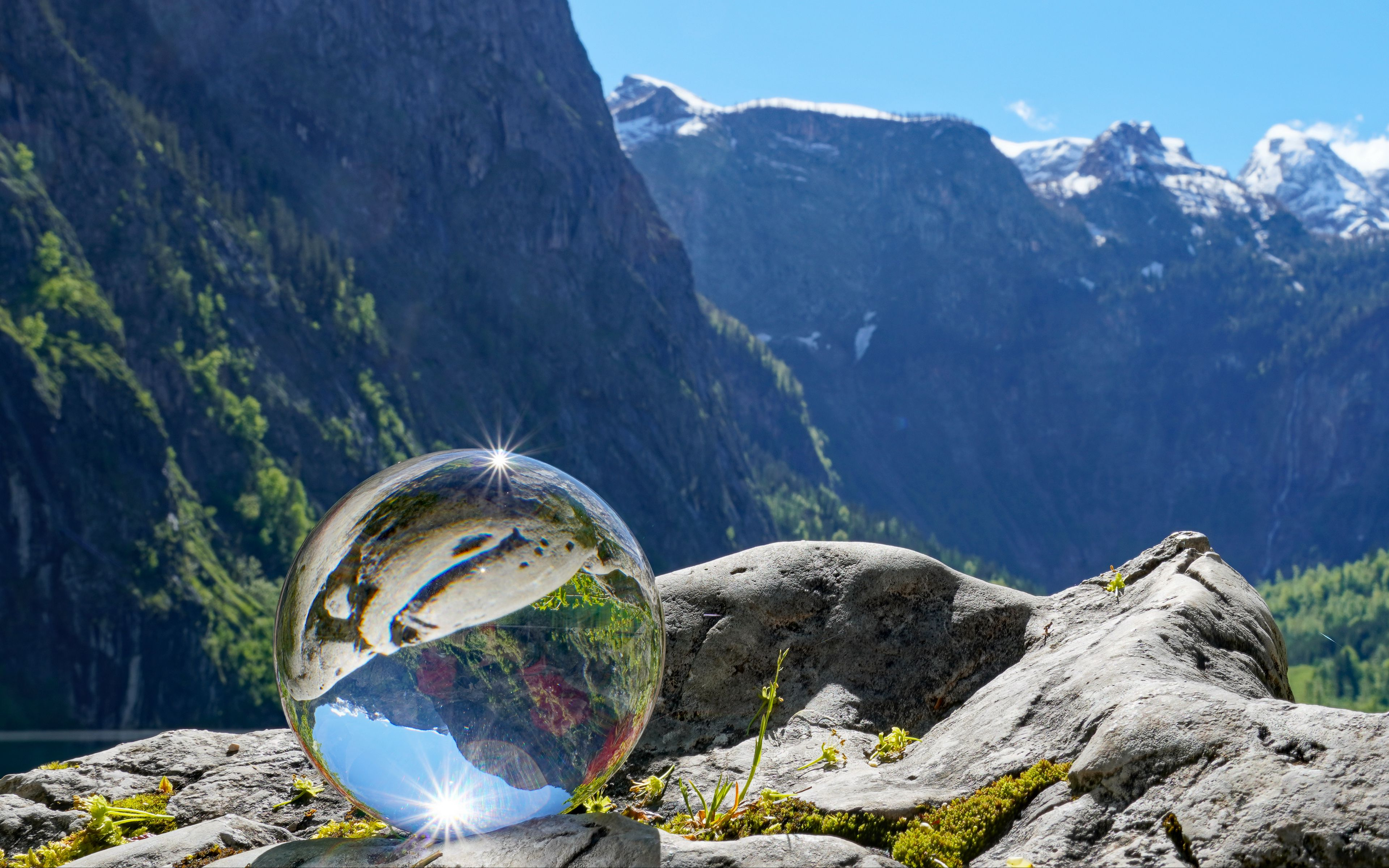 Wallpaper Glass ball reflecting the mountains