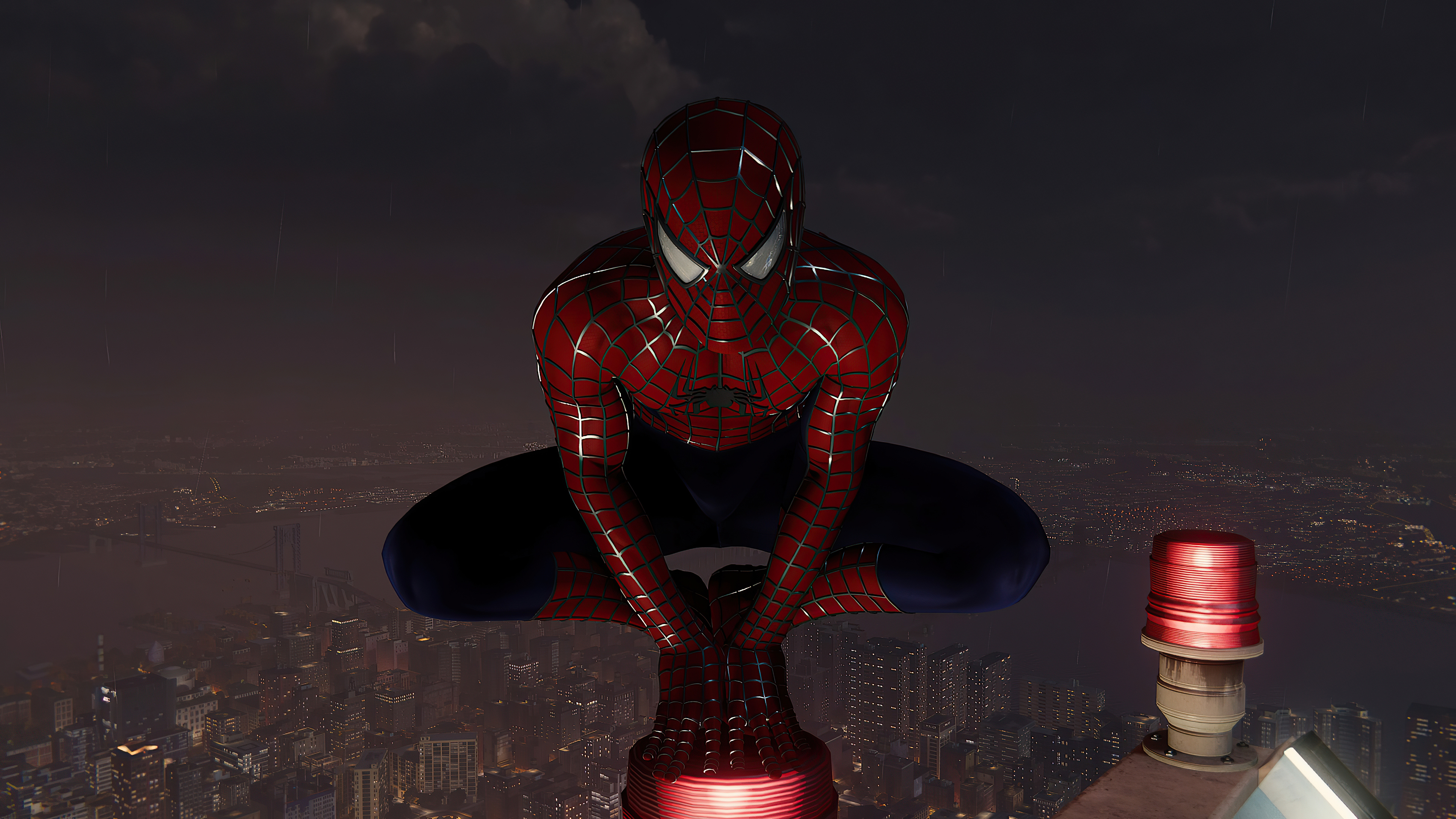 Fondos de pantalla El hombre araña en la cima de la ciudad