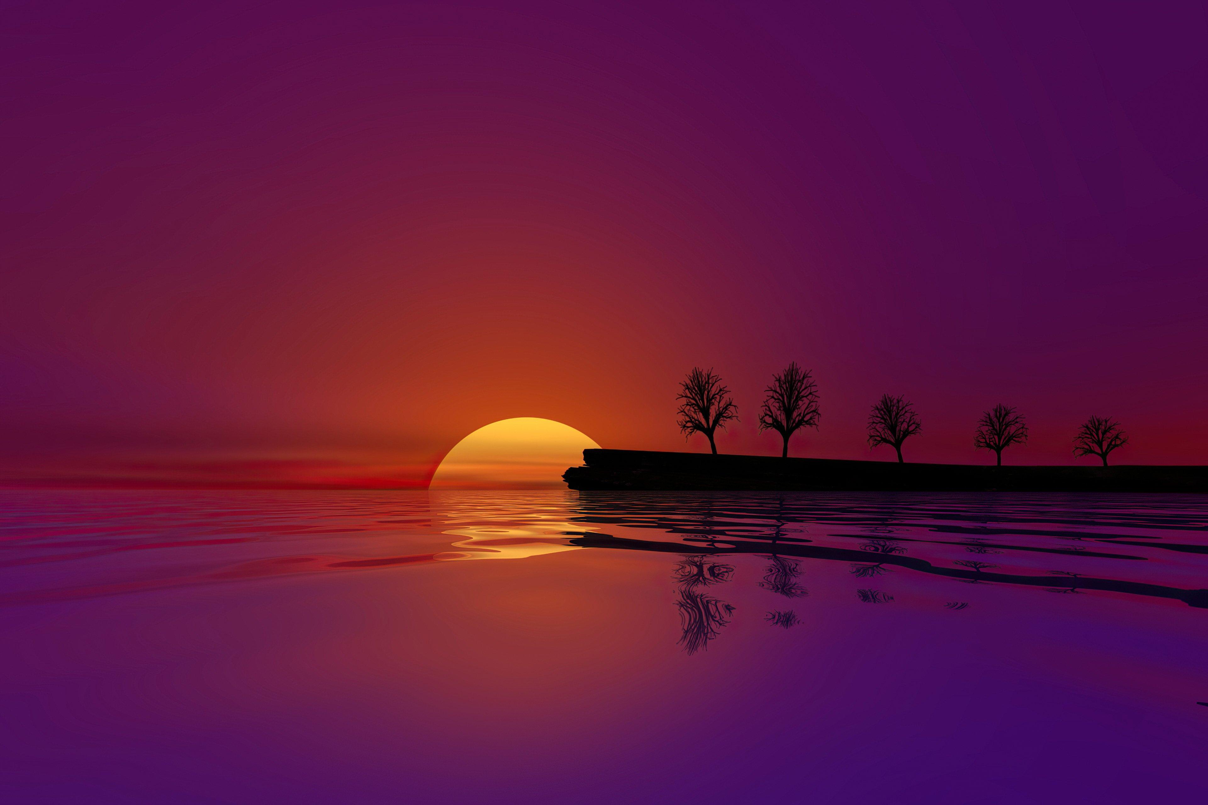 Fondos de pantalla El sol escondiendose en el agua