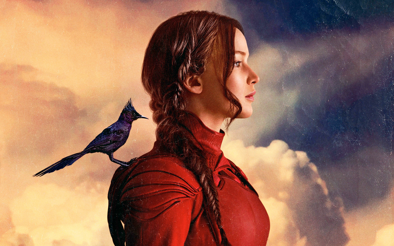 Fondos de pantalla Katniss Everdeen con un Sinsajo