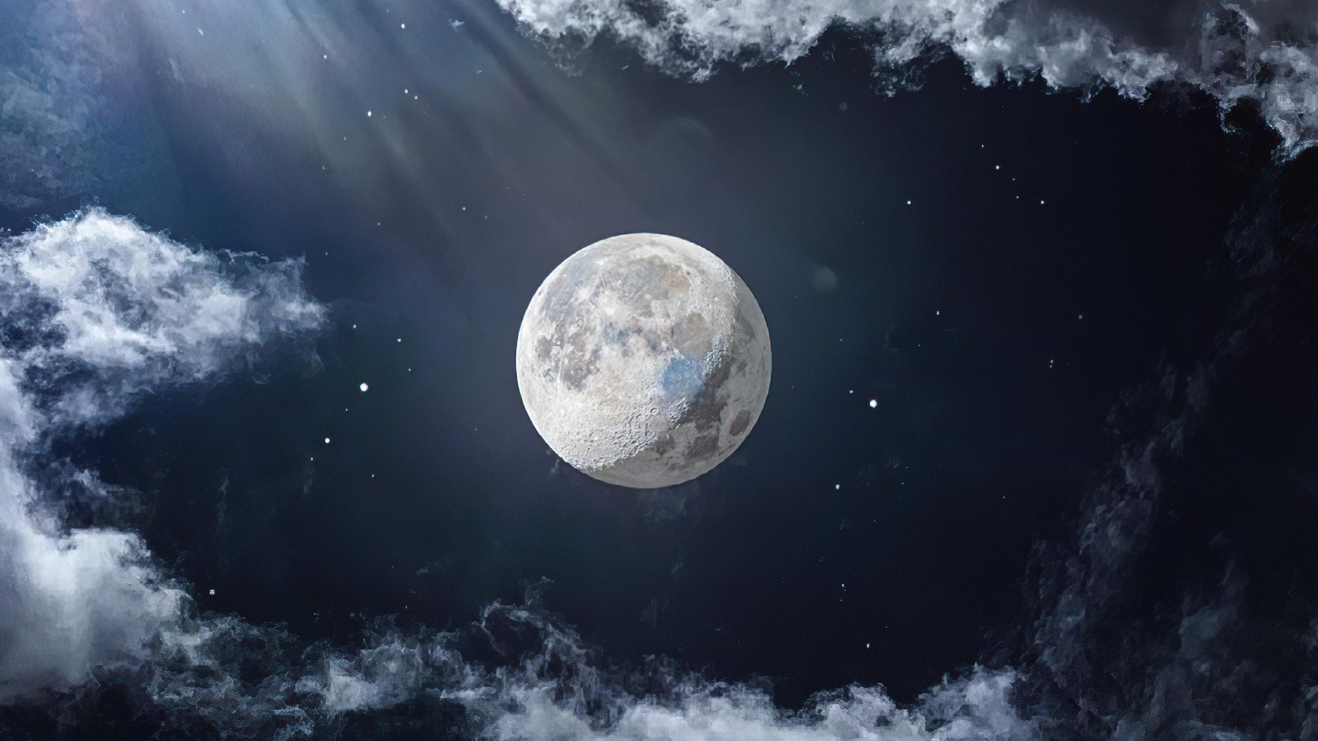 Fondos de pantalla La luna junto a nubes
