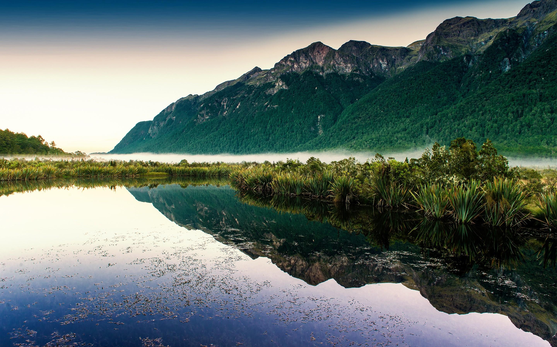 Wallpaper Lake reflecting mountains