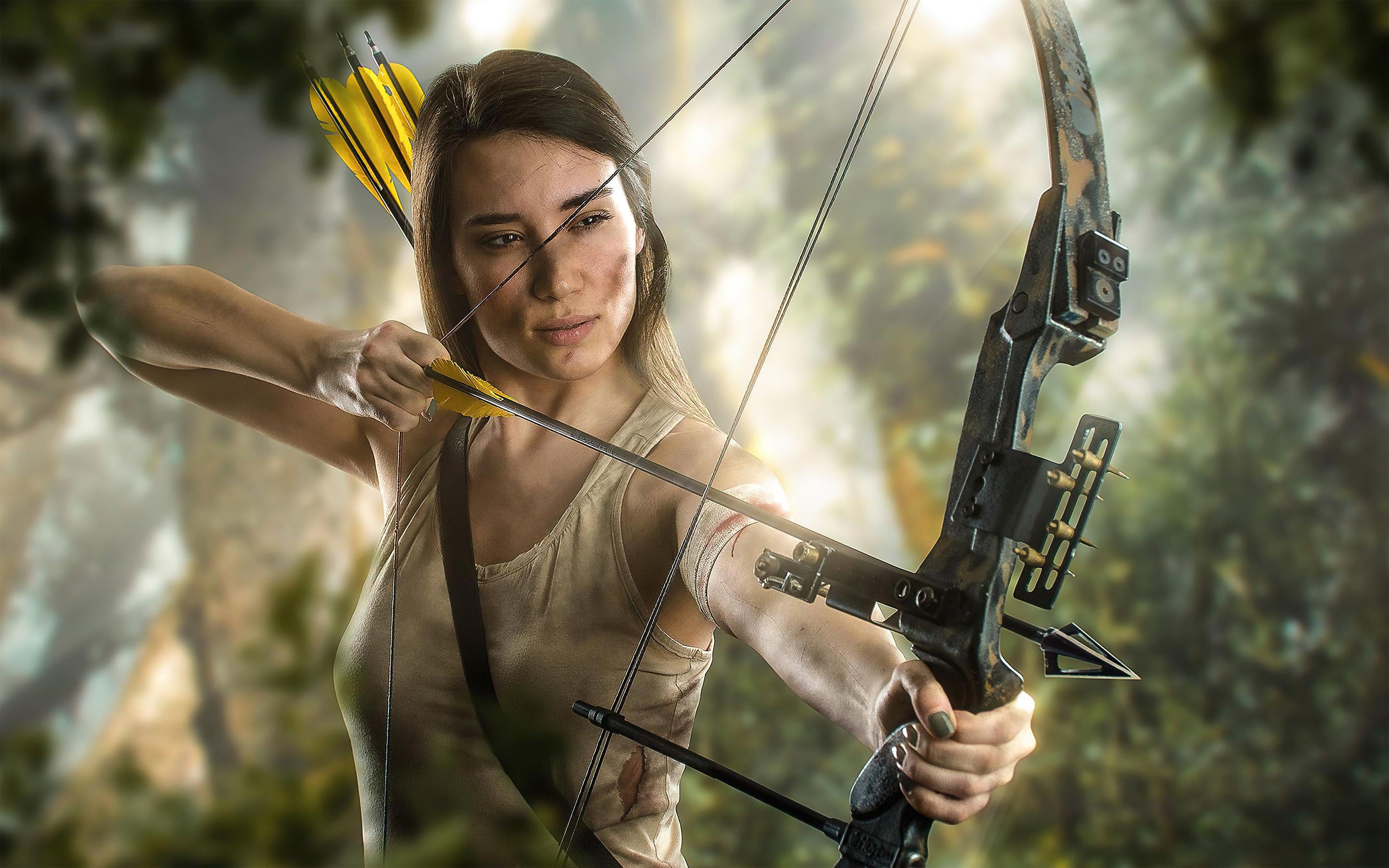 Fondos de pantalla Lara Croft con arco y flecha