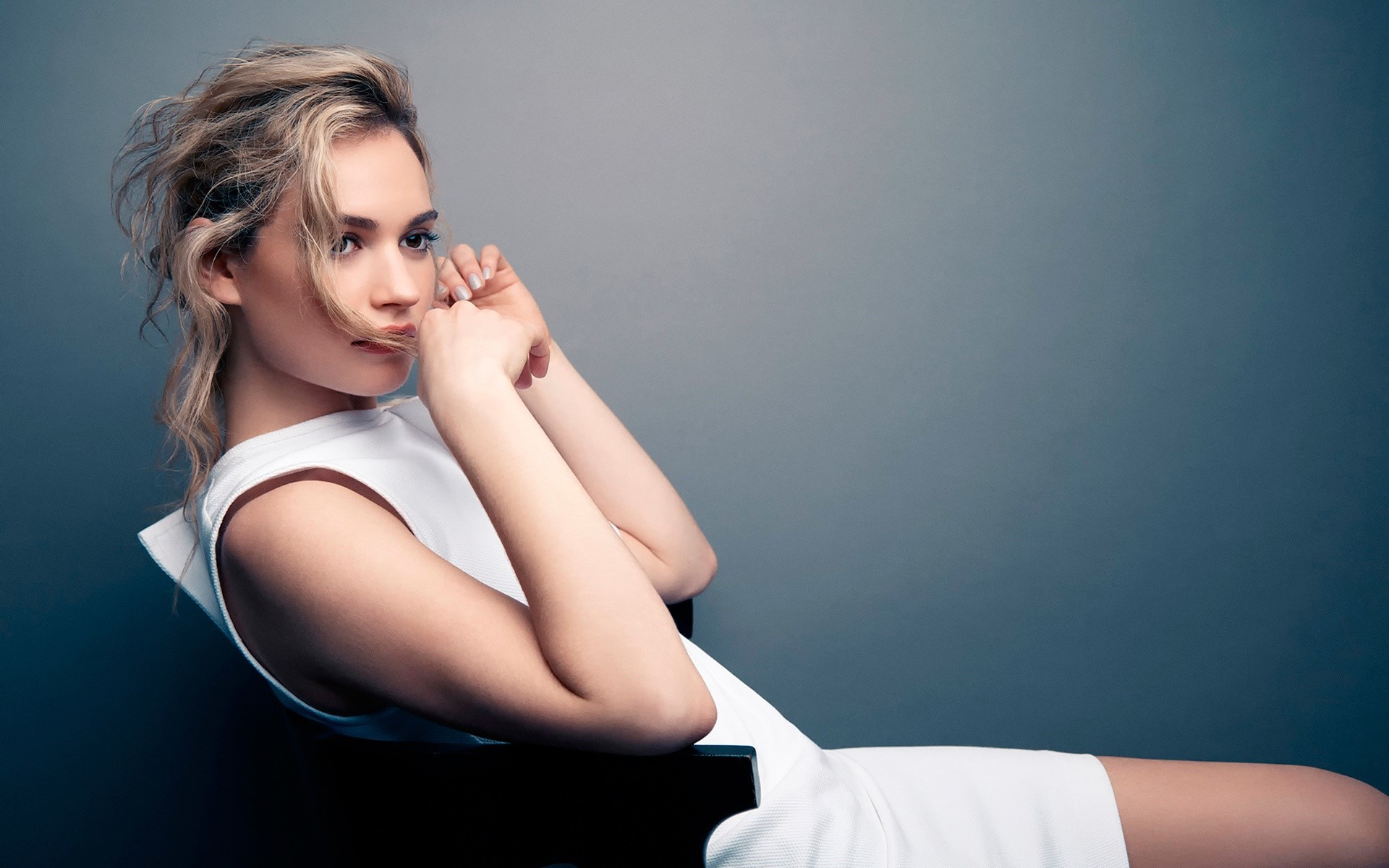 Wallpaper Lily James in a chair