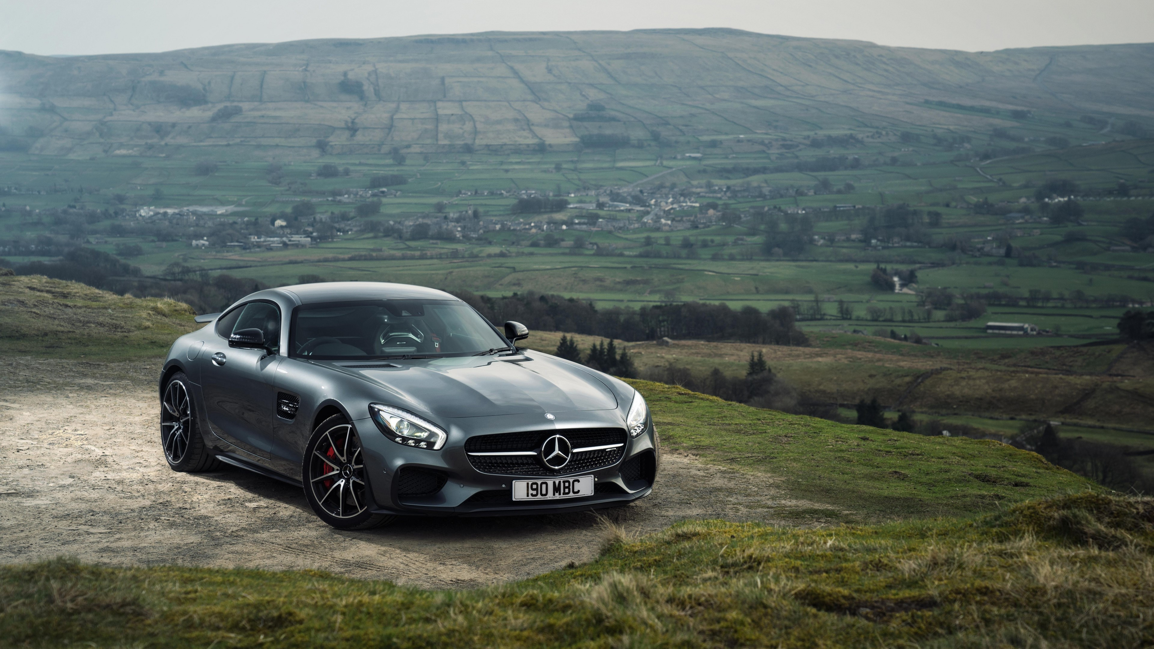 Wallpaper Mercedes AMG GT S gray in mountains