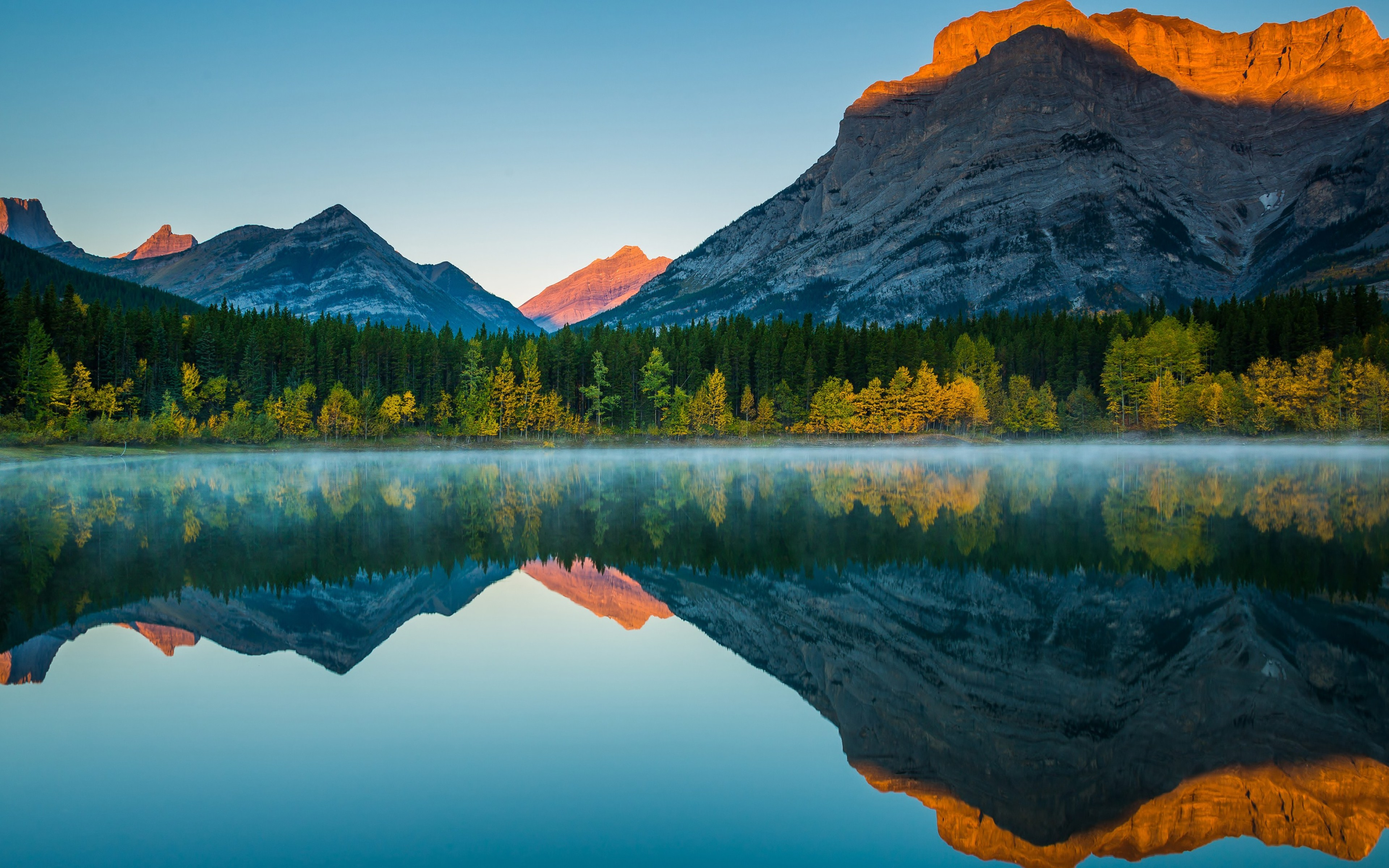 Wallpaper Mountains reflected in lake at sunset
