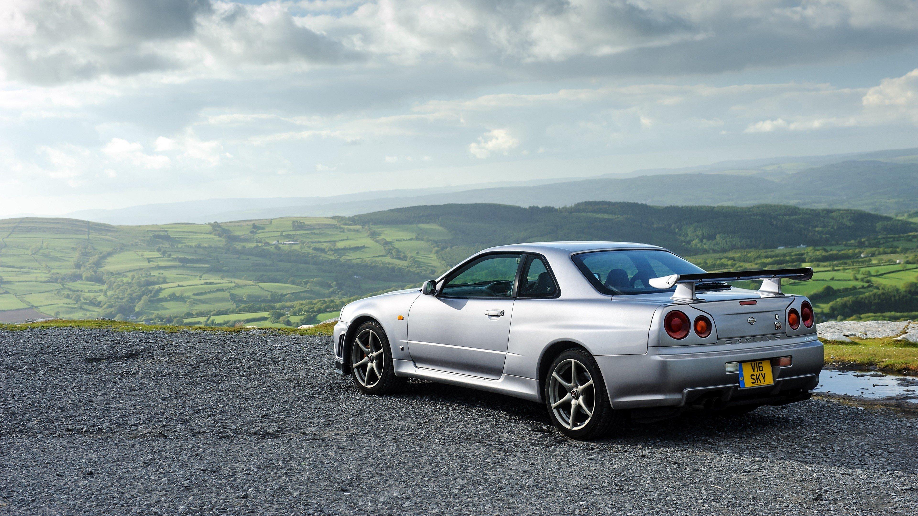 Fondo de pantalla de Nissan Skyline GT R gris de lado Imágenes