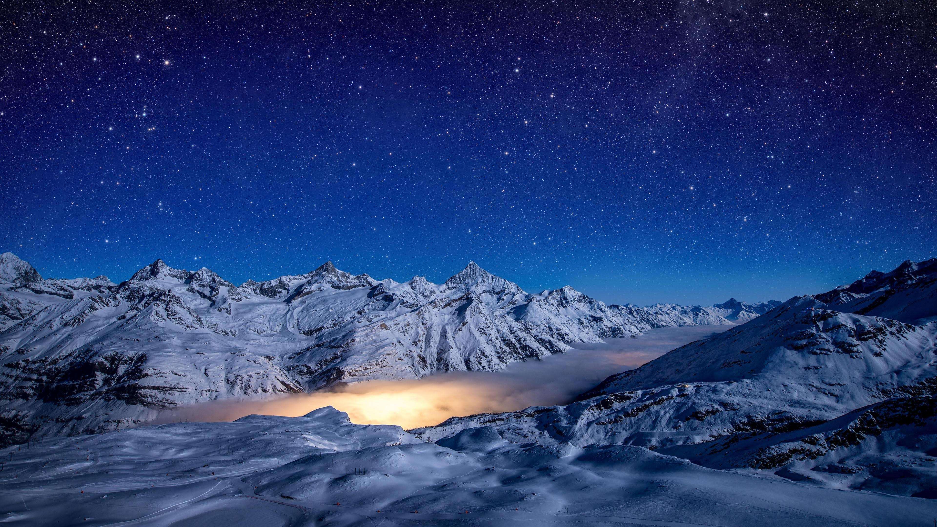 Wallpaper Starry night snow covered mountains