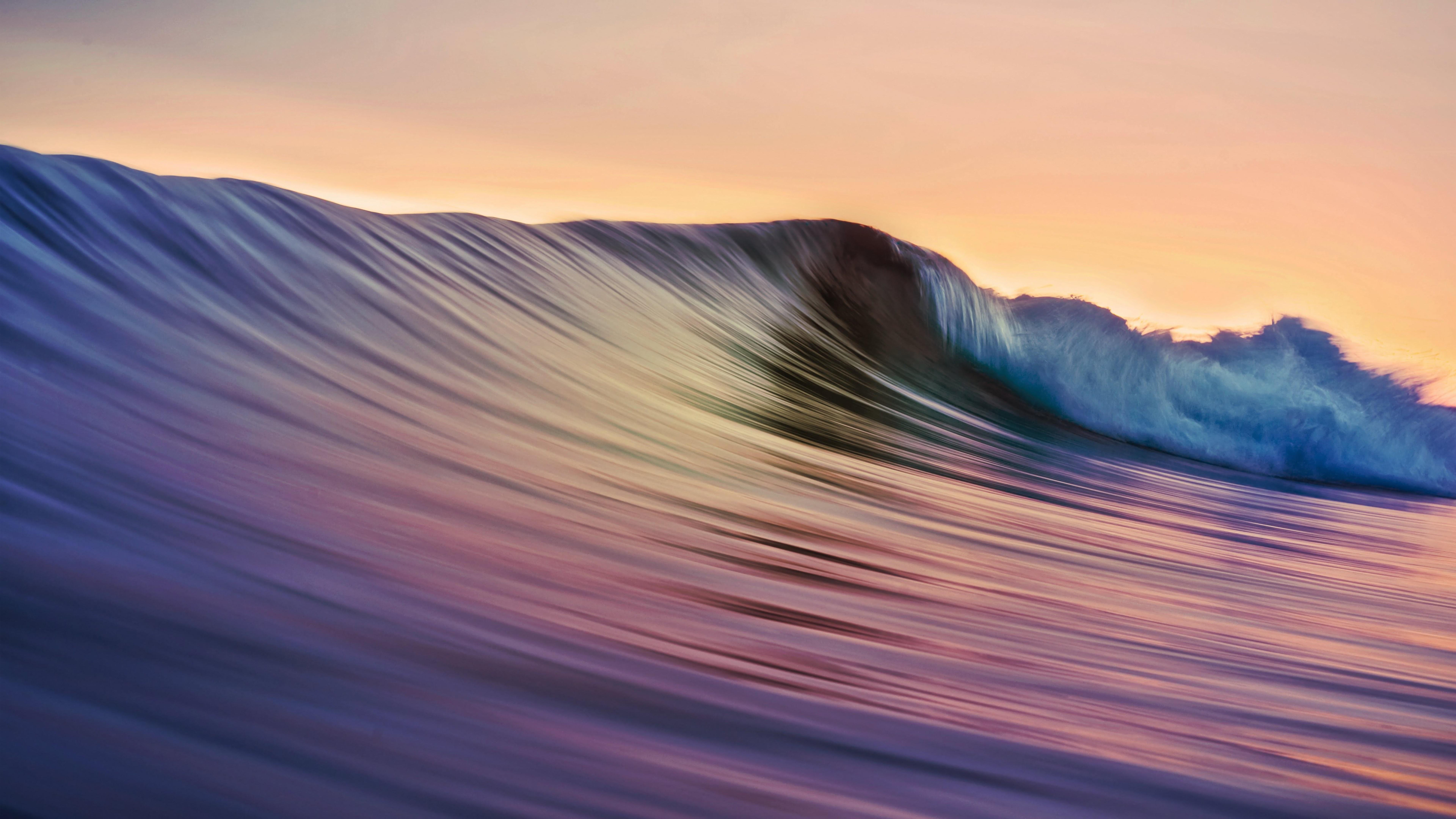 Wallpaper Wave reflecting sunset