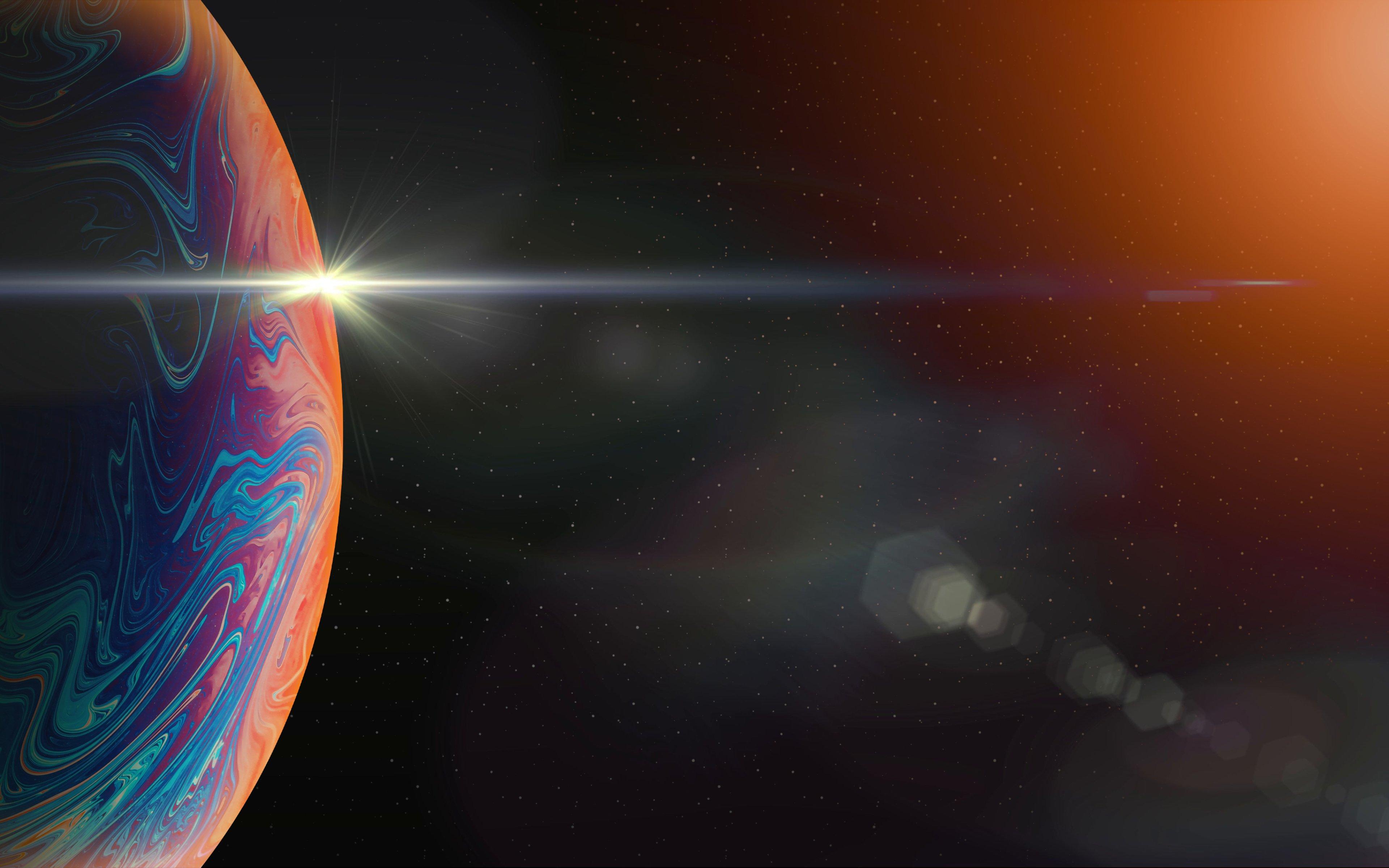 Fondos de pantalla Planeta de colores a la luz del sol