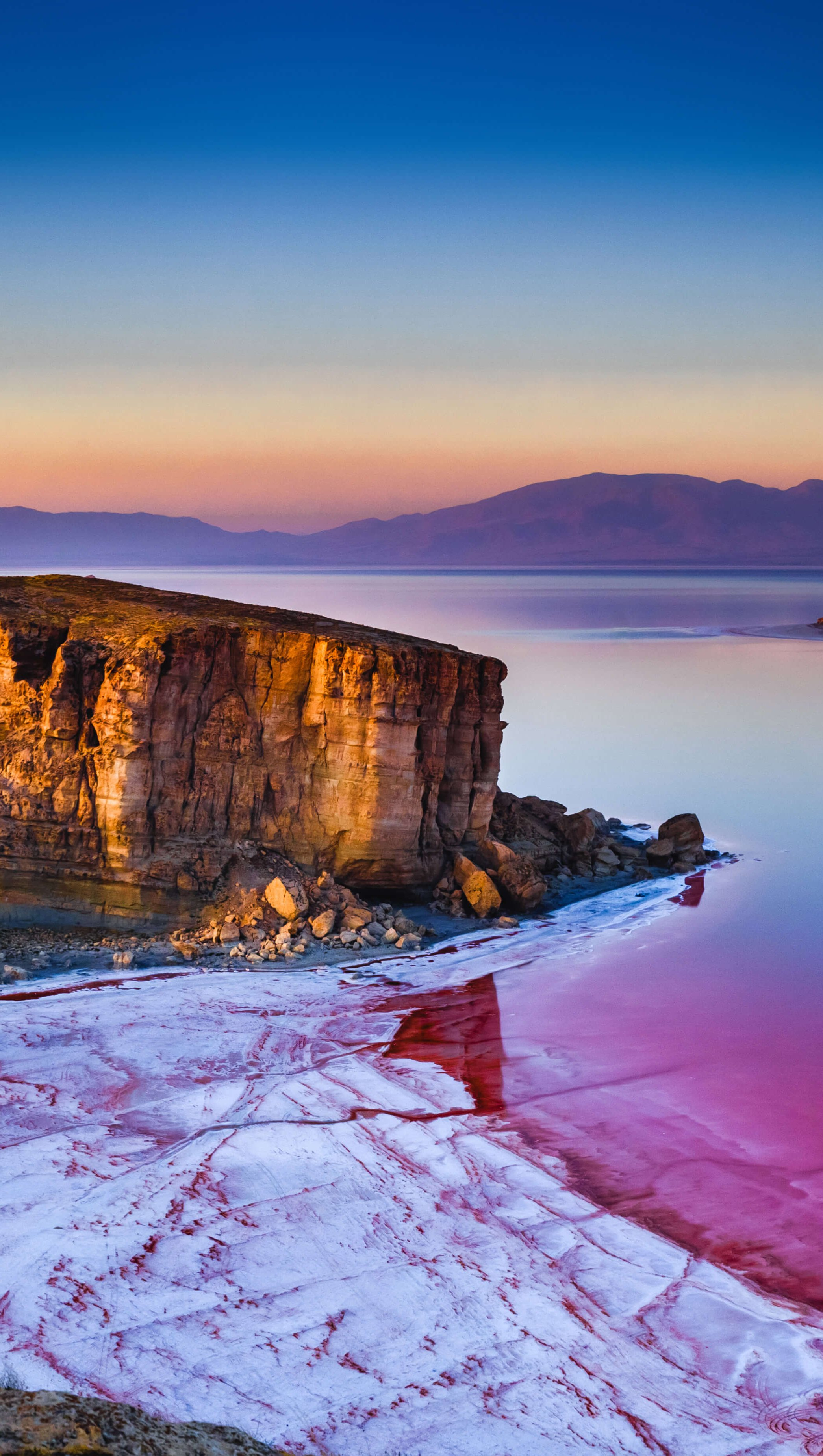 Fondos de pantalla Amanecer en la playa convirtiendose rosa Vertical
