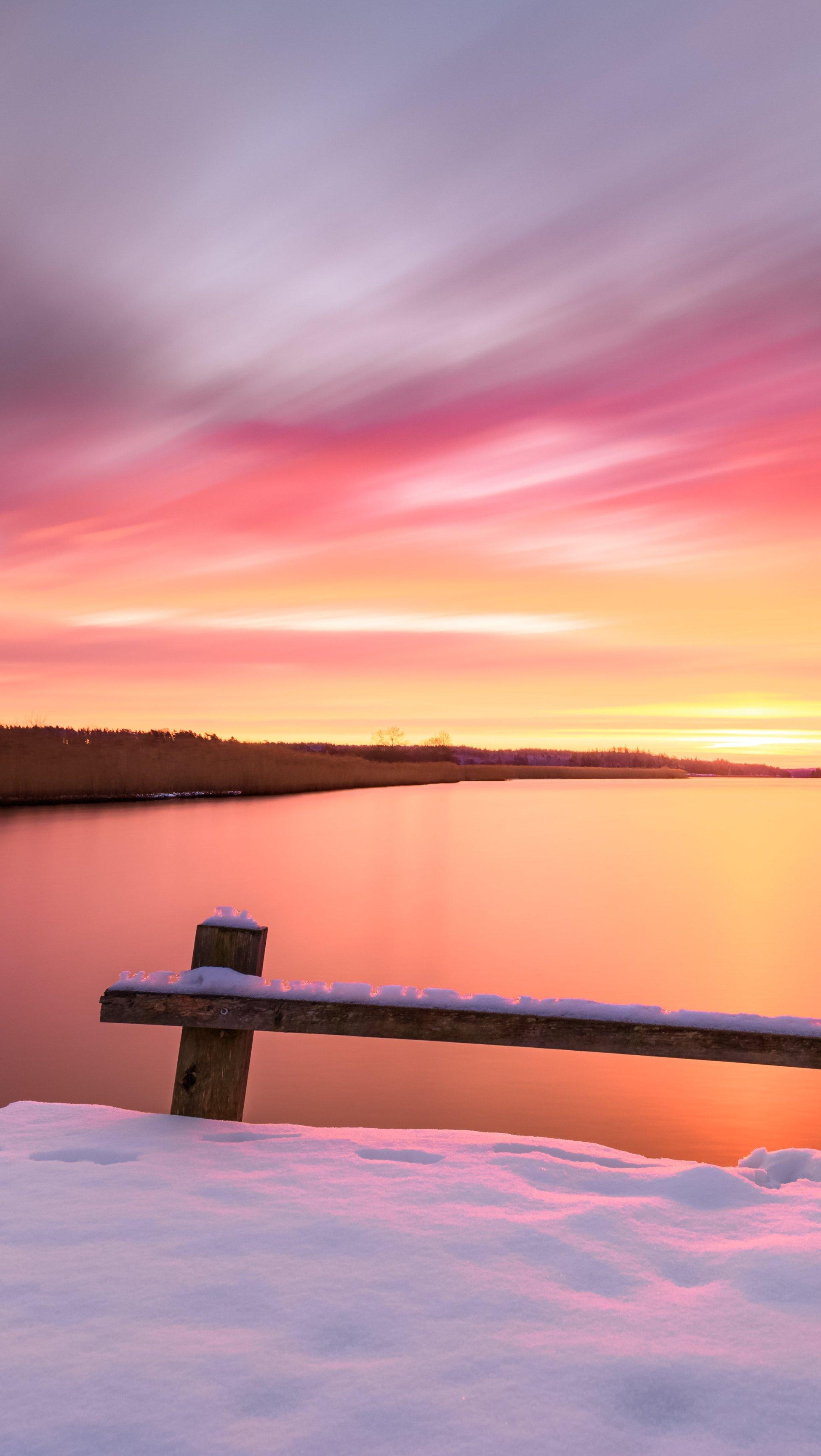 Fondos de pantalla Amanecer en lago con nieve Vertical