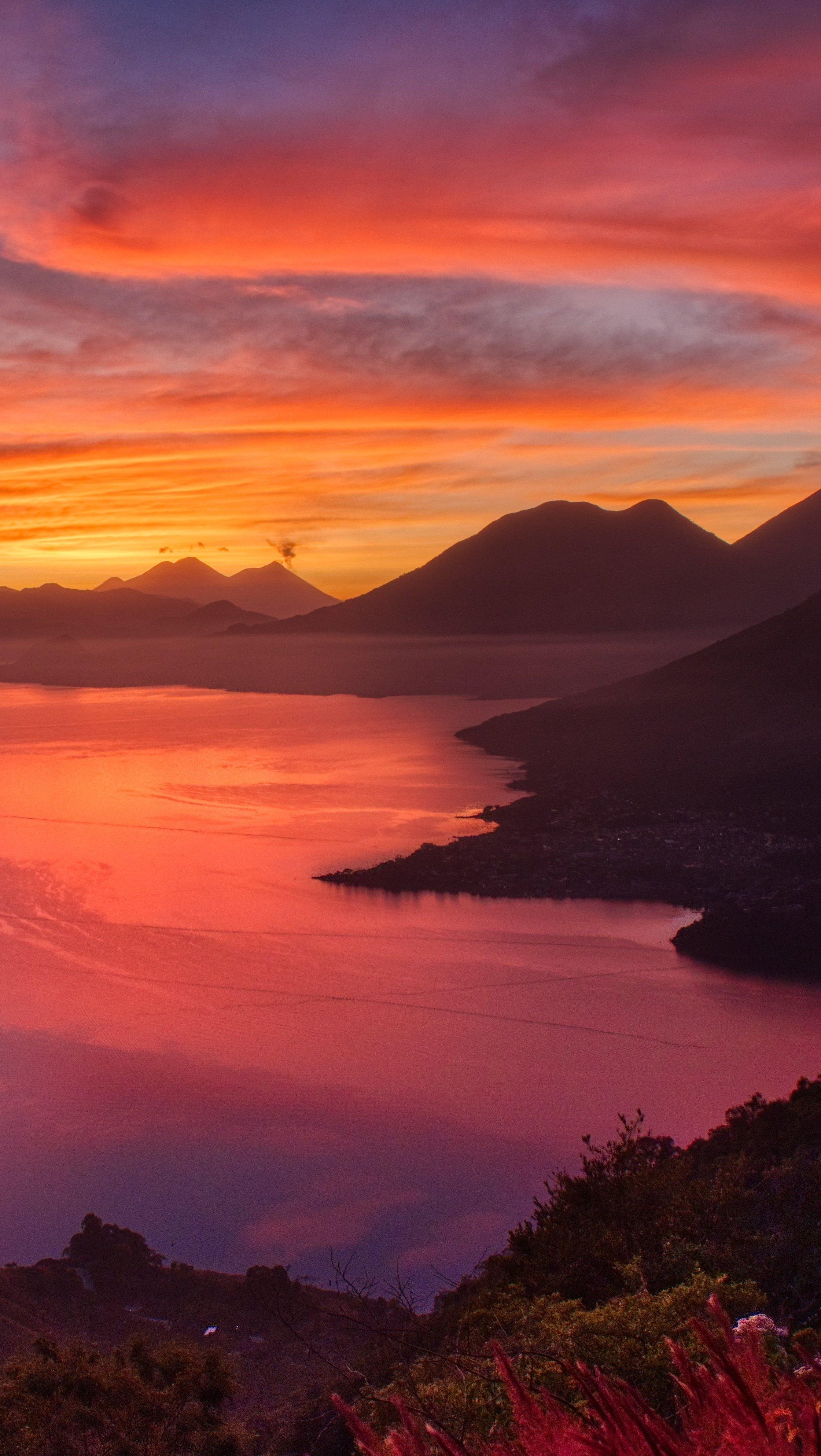 Wallpaper Sunrise at lake beside mountains Vertical