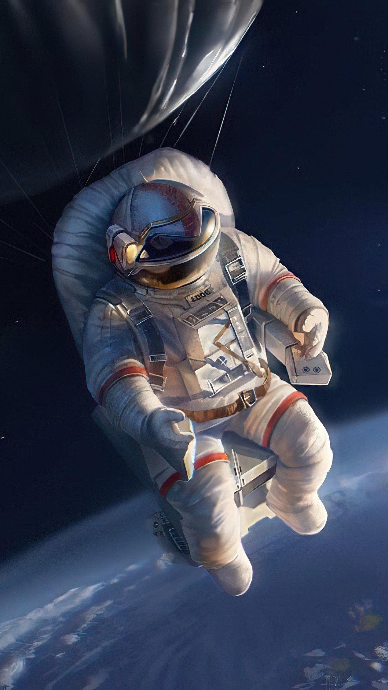 Fondos de pantalla Astroauta arriba de la tierra Vertical
