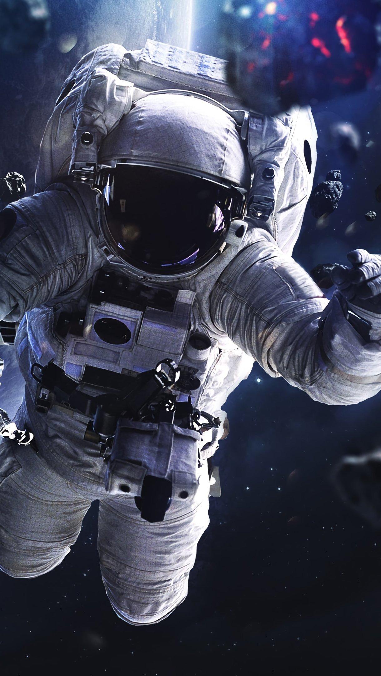 Wallpaper Astronaut floating around asteroids Vertical