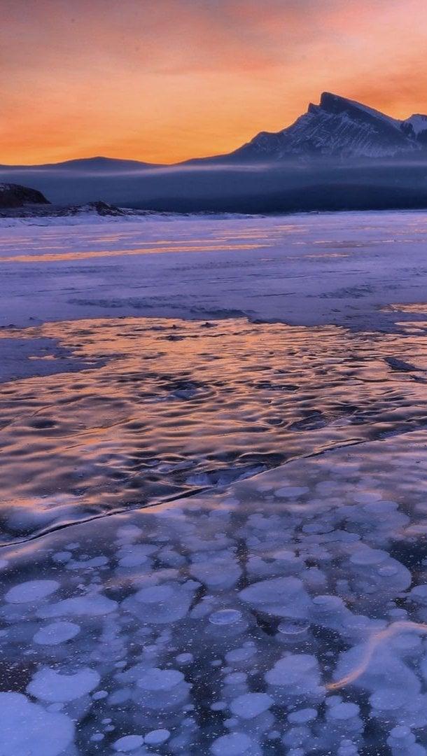 Wallpaper Sunset at frozen lake Vertical