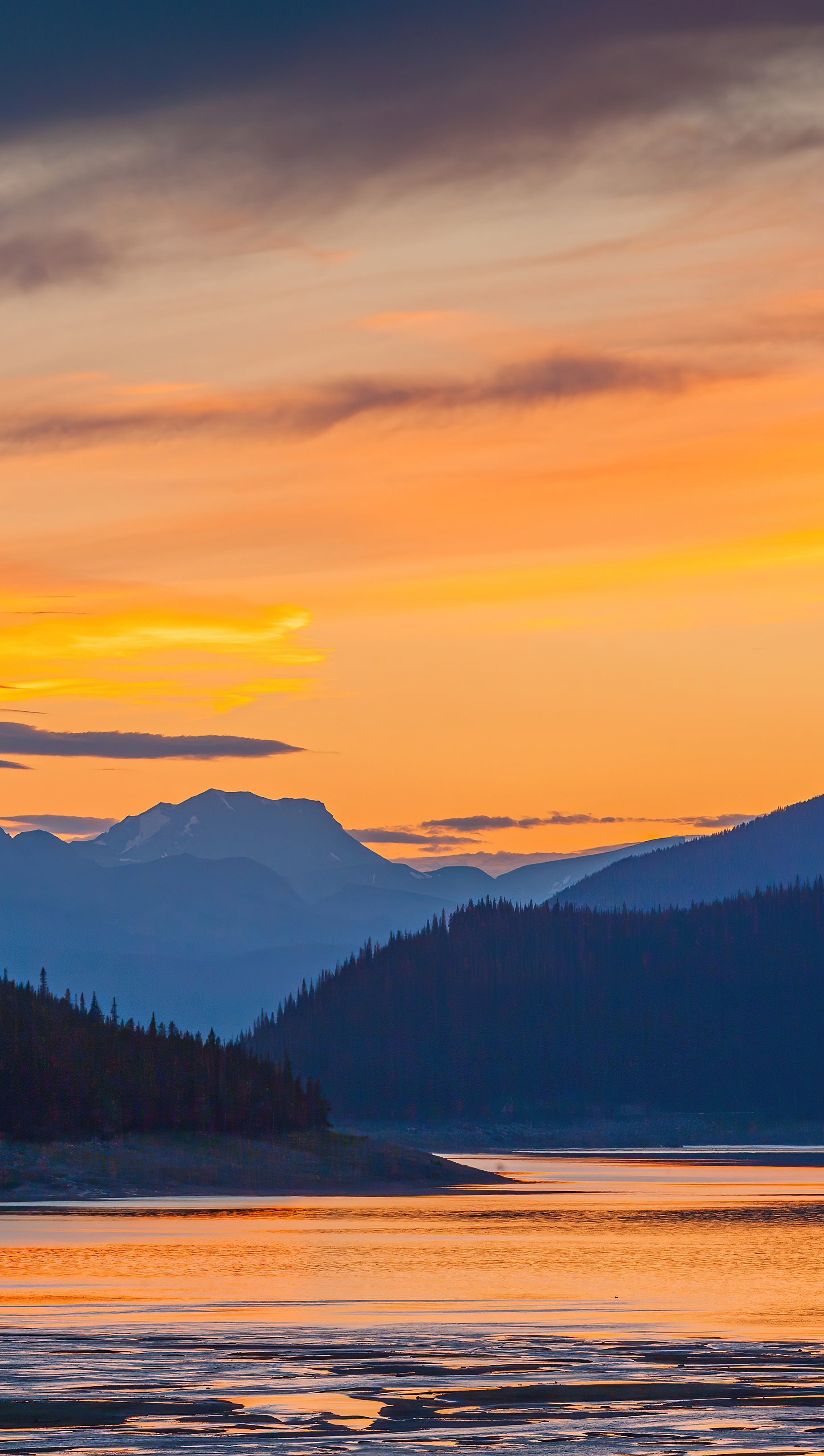 Wallpaper Sunset in lake next to mountains Digital Art Vertical