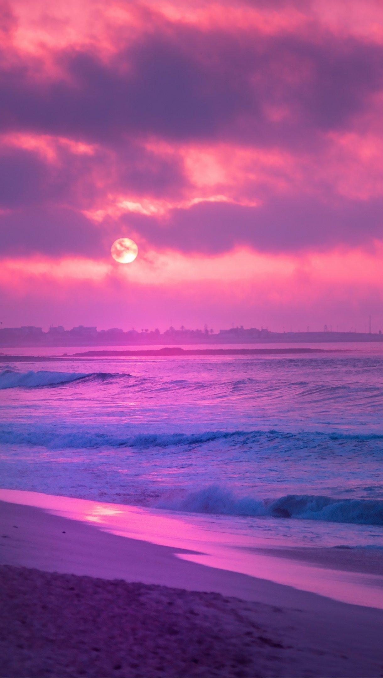 Fondos de pantalla Atardecer rosa en la playa Vertical