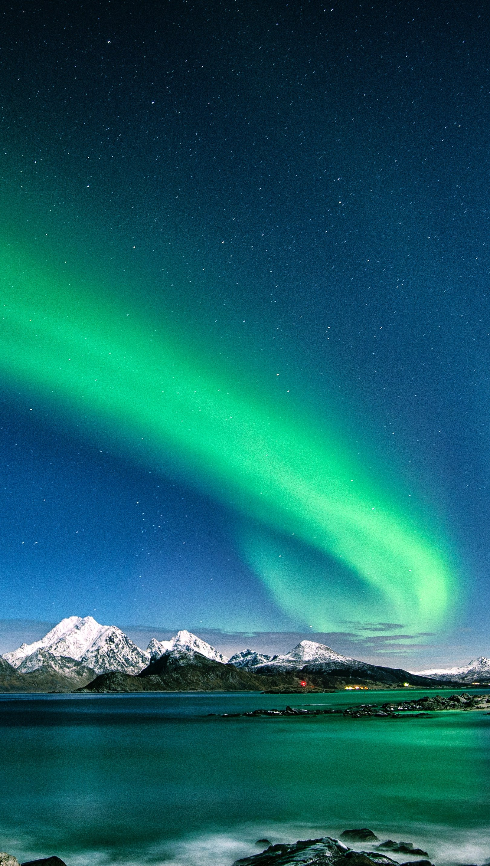 Wallpaper Northern lights in mountains and lake Vertical