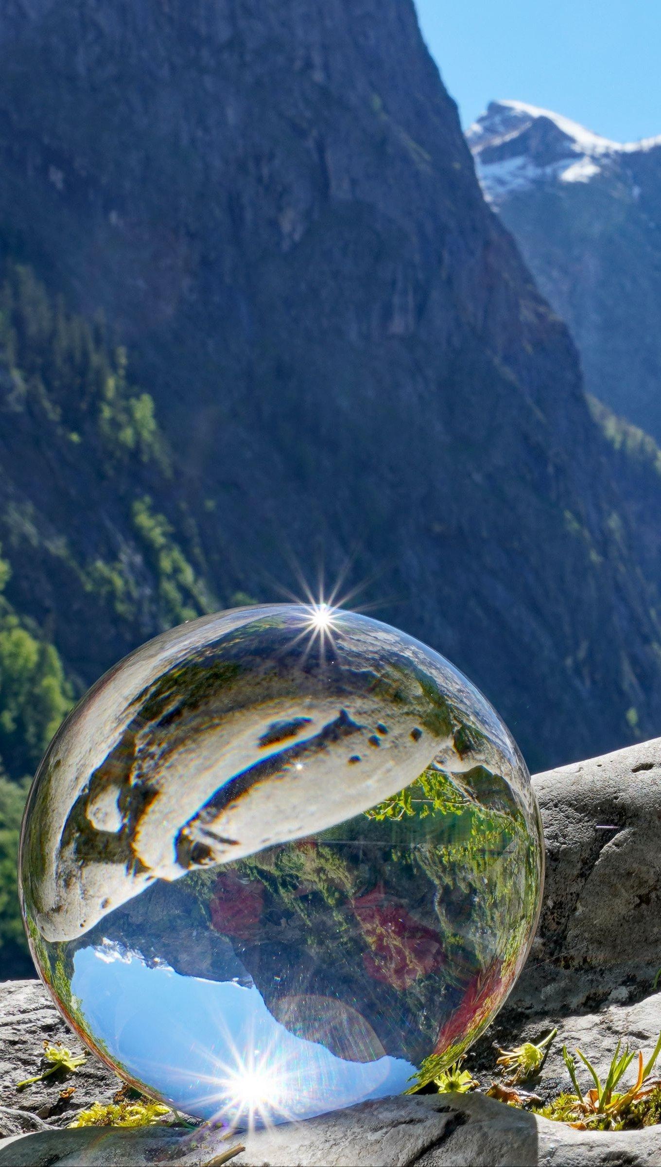 Wallpaper Glass ball reflecting the mountains Vertical
