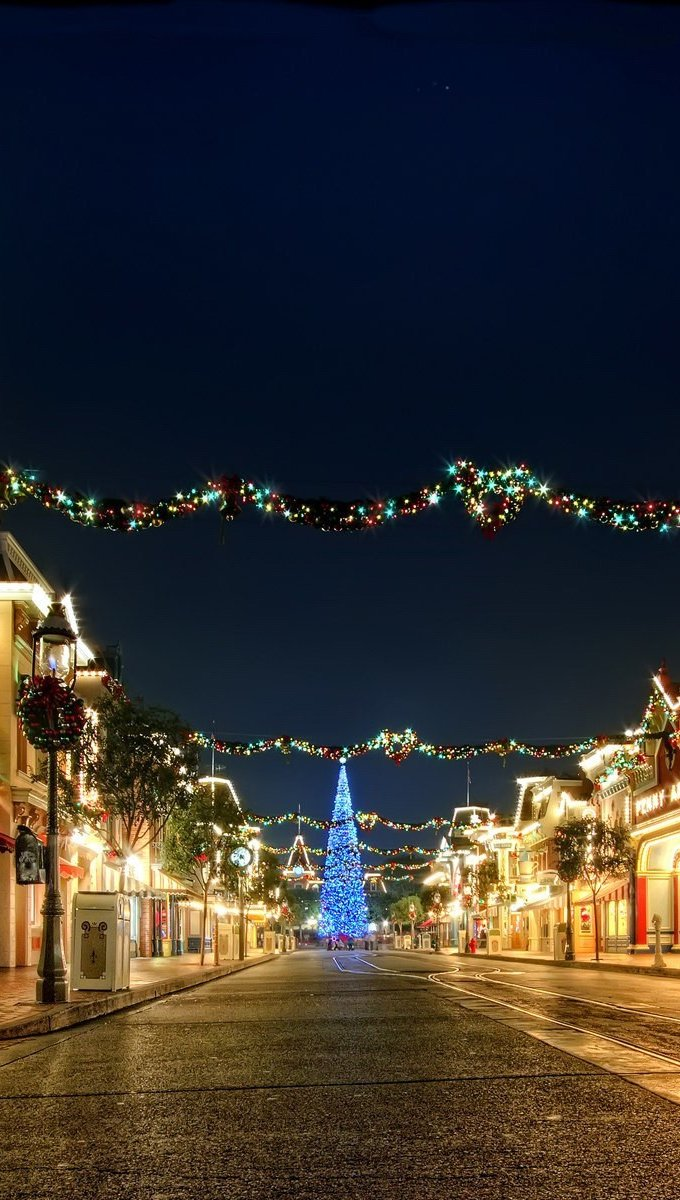 Wallpaper Streets with Christmas lights and ornaments Vertical