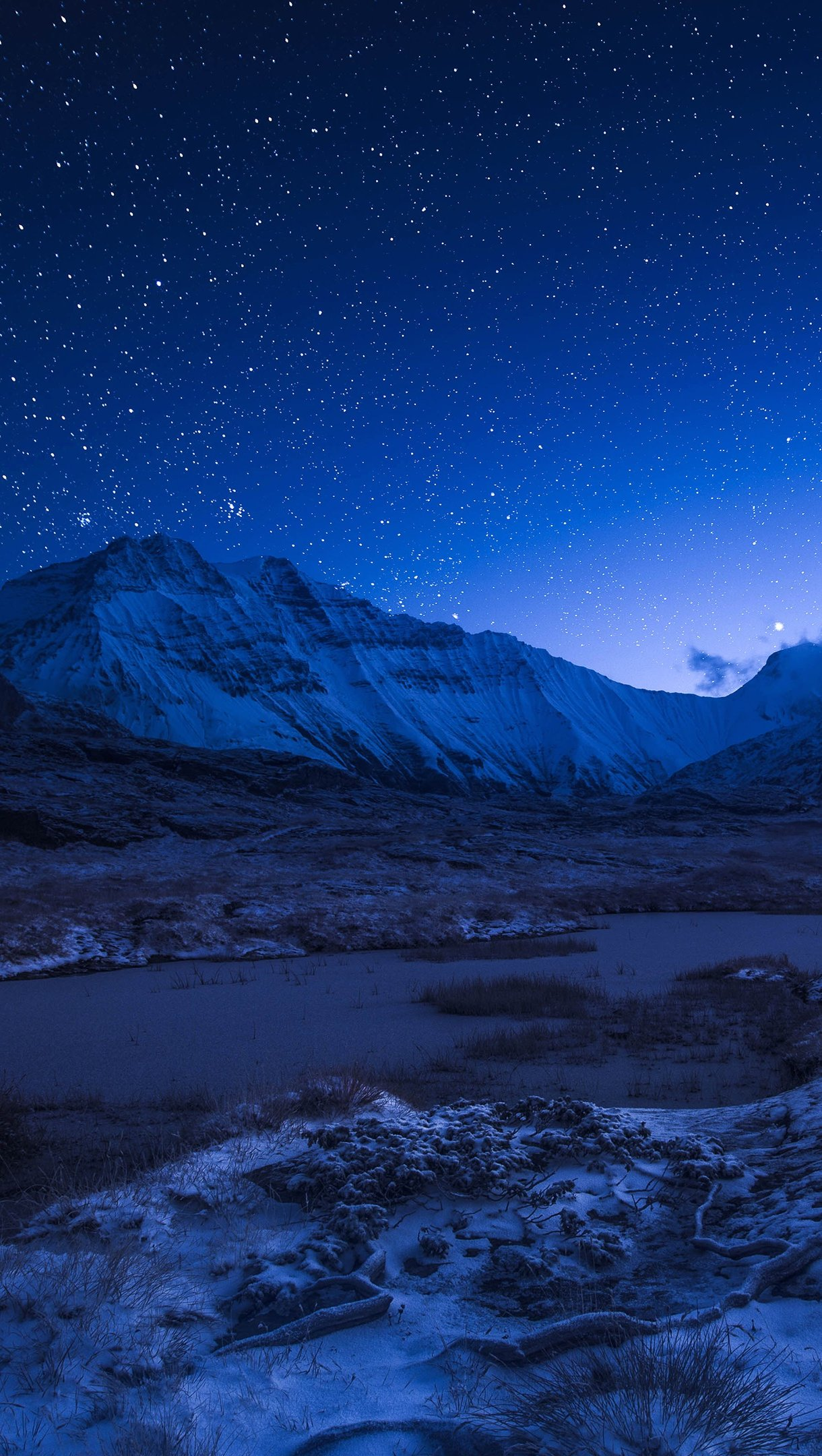 Wallpaper Starry night sky above the snowy mountains Vertical