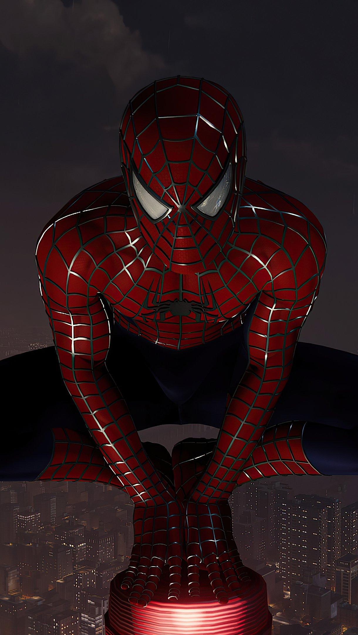 Fondos de pantalla El hombre araña en la cima de la ciudad Vertical