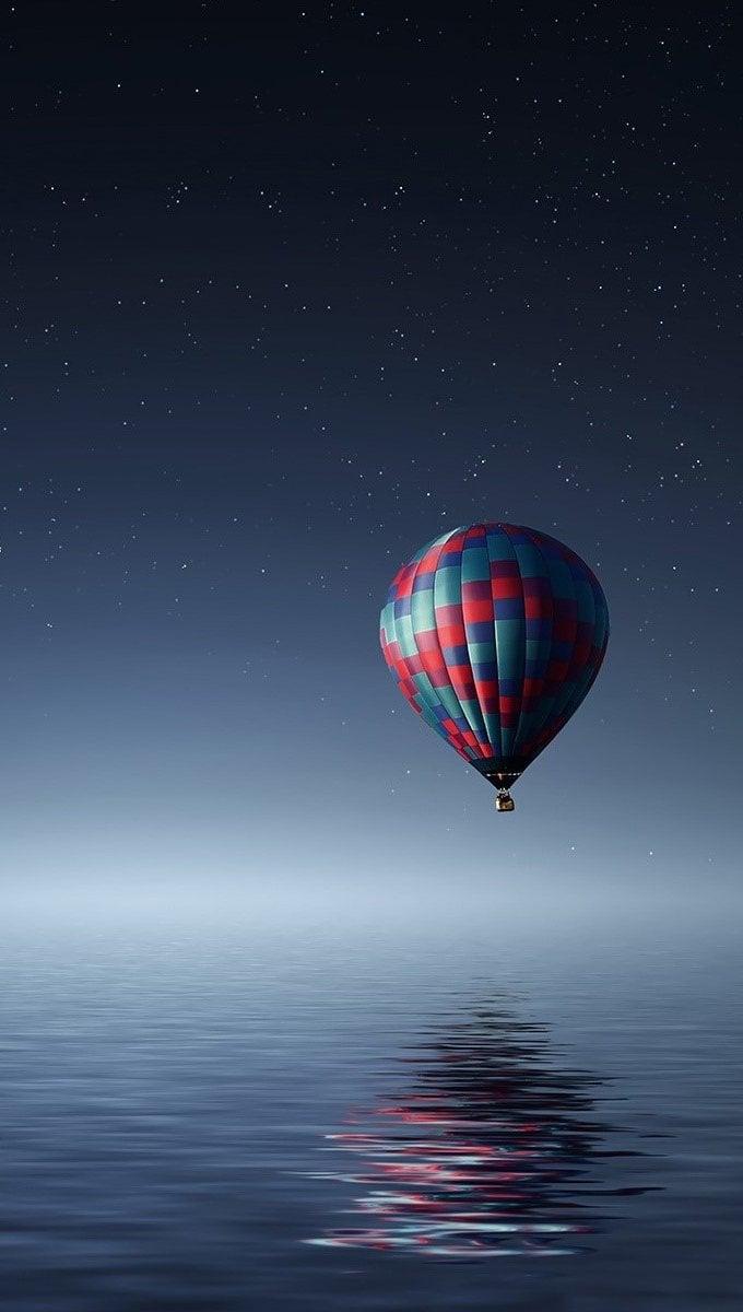 Wallpaper Hot air balloon in nothingness Vertical