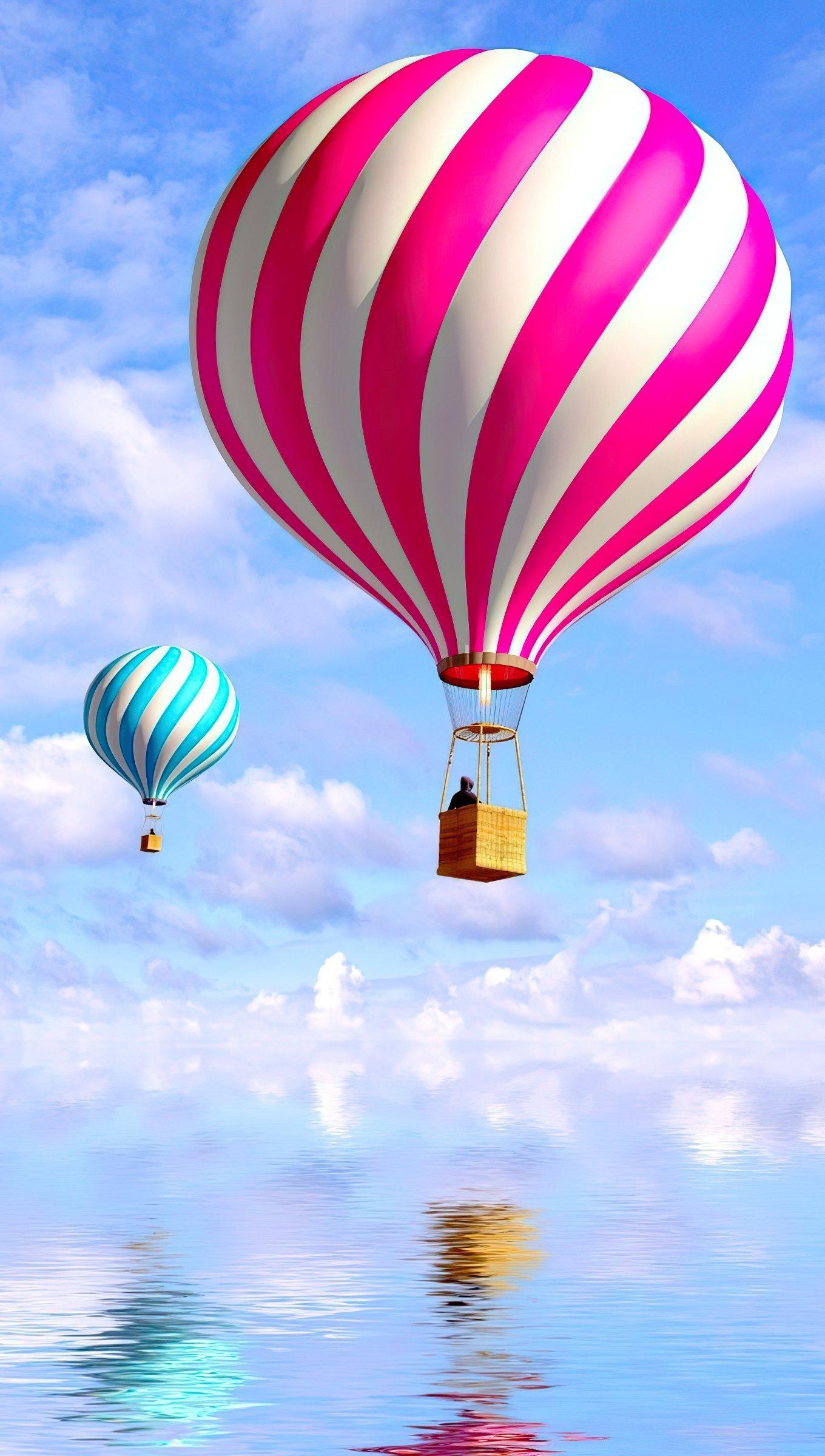 Fondos de pantalla Globos aerostáticos en las nubes Vertical