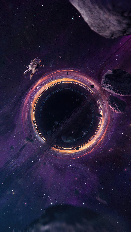 Fondos de pantalla Hoyo negro alrededor de asteroides y planetas Vertical