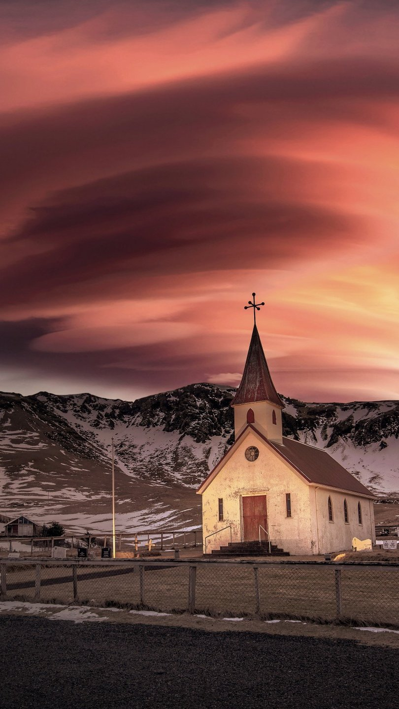Wallpaper Chruch in the middle of mountains with snow Vertical