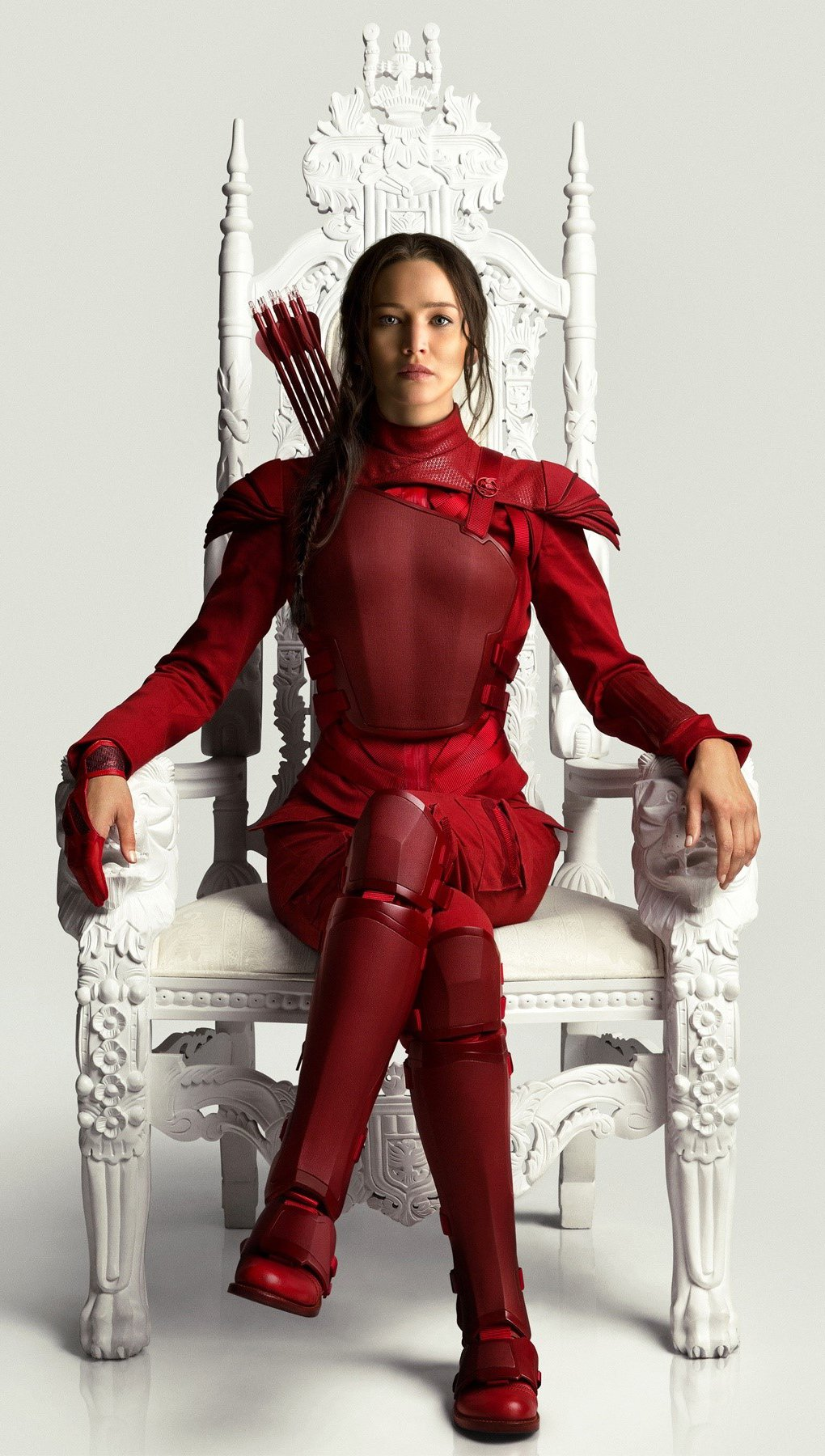 Wallpaper Katniss in her red suit Vertical
