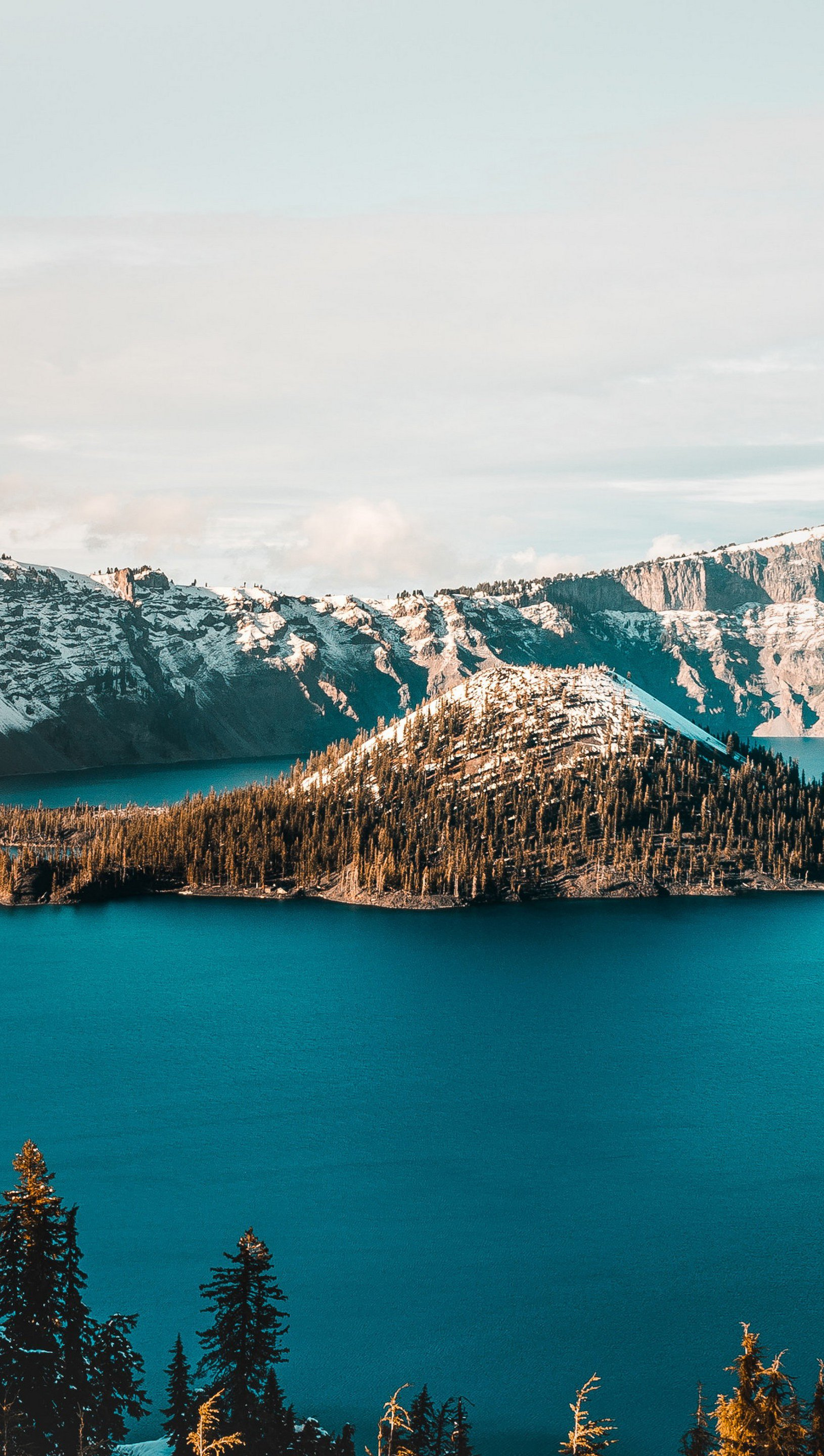 Wallpaper Lake in snowy mountains Vertical