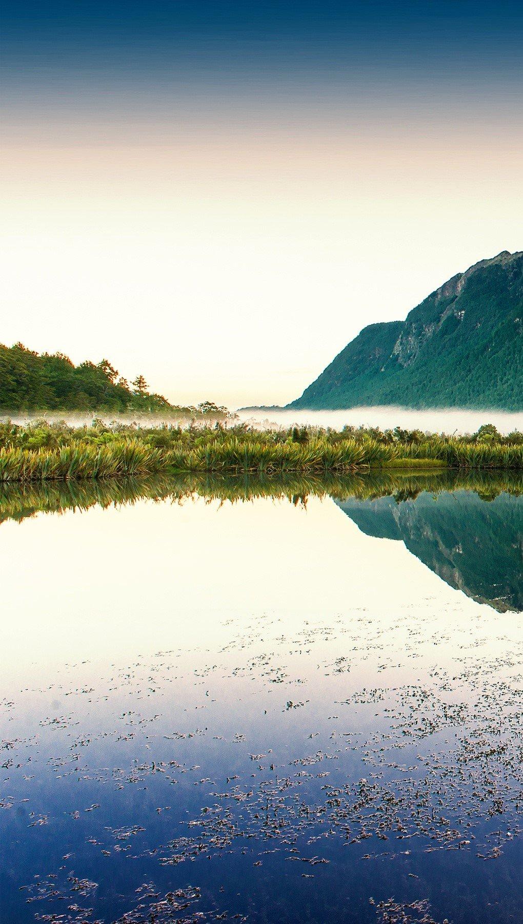 Wallpaper Lake reflecting mountains Vertical