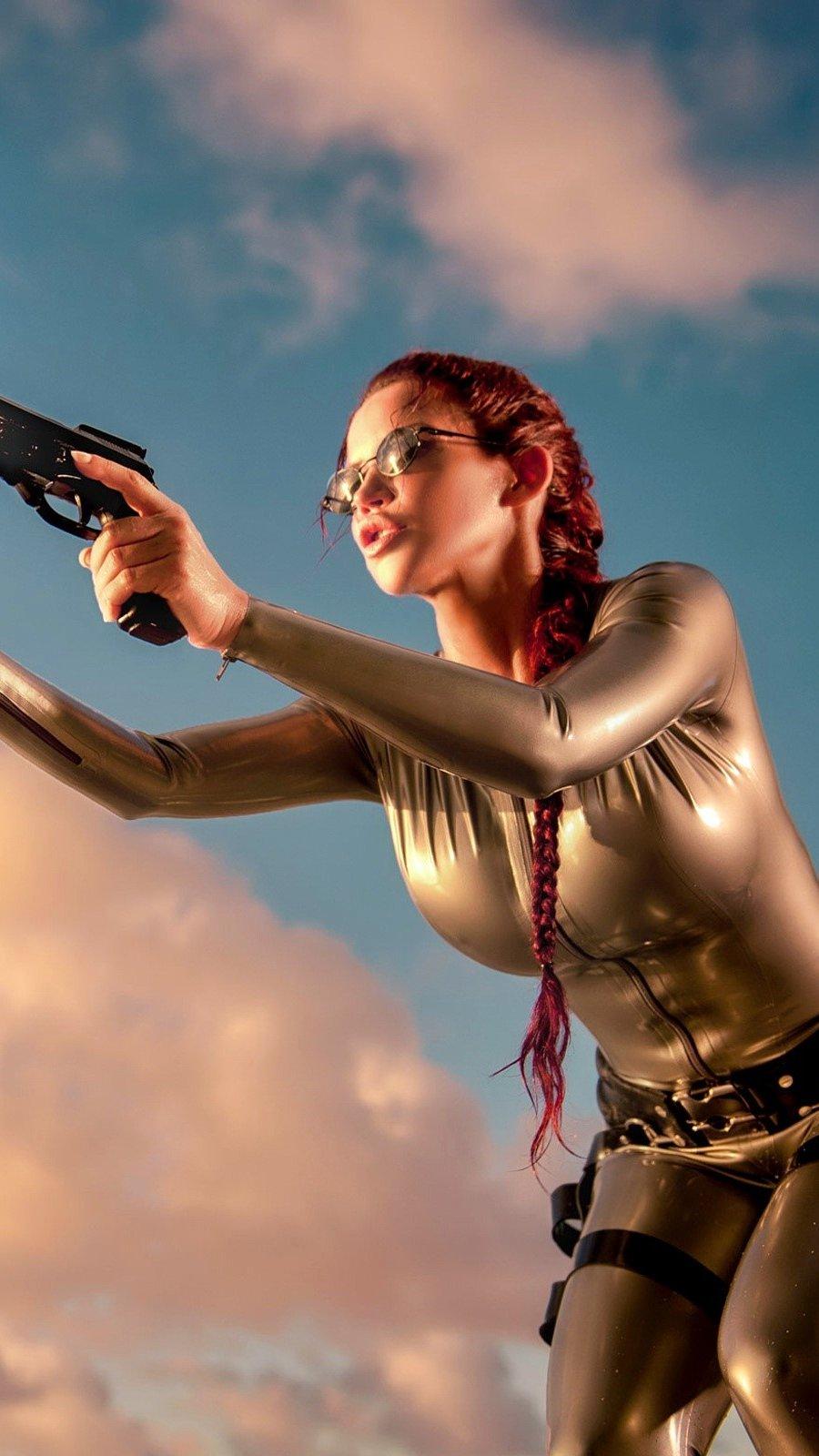 Fondos de pantalla Lara Croft con pistolas Vertical