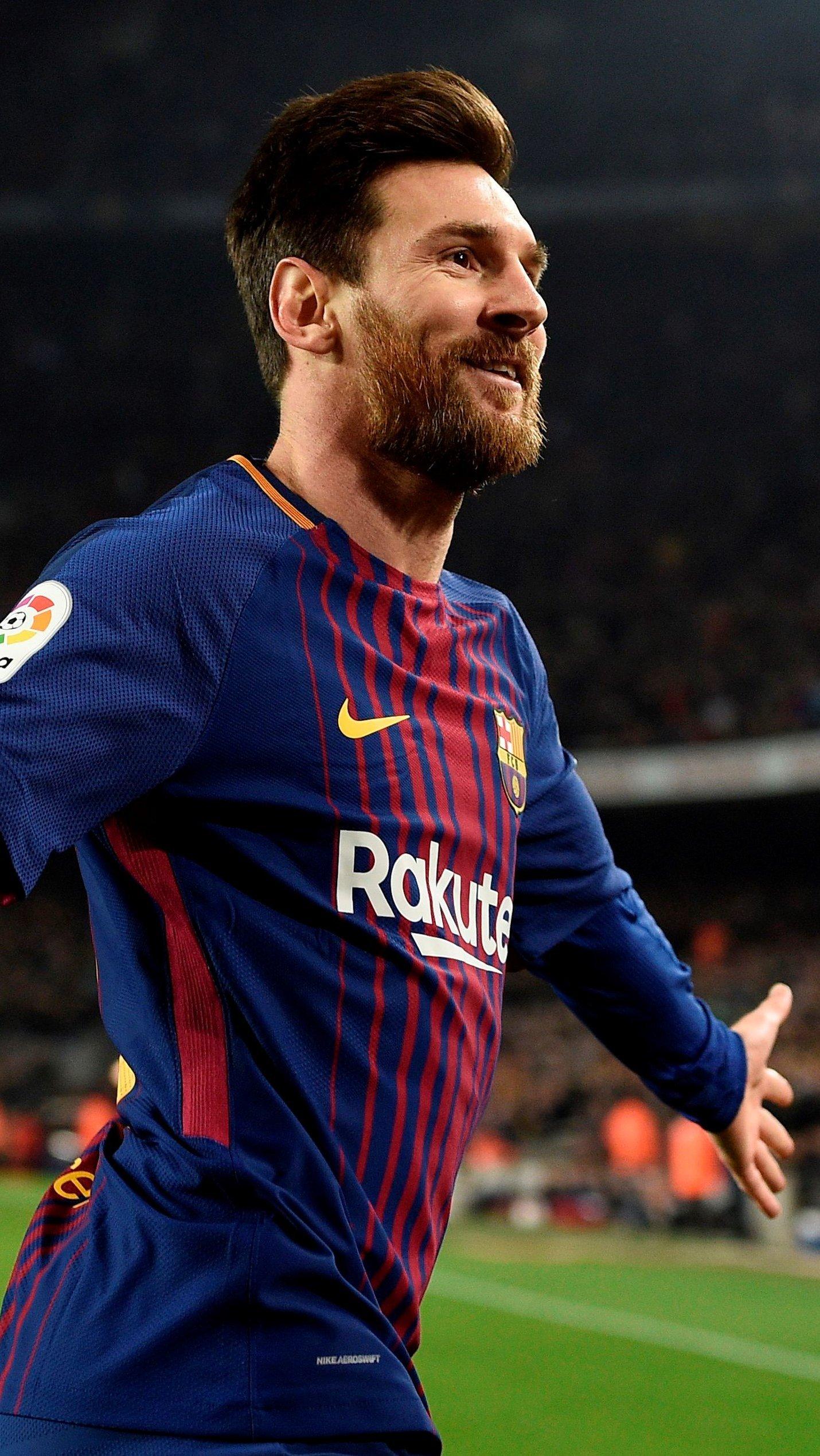 Fondos de pantalla Lionel Messi con el Barcelona Vertical