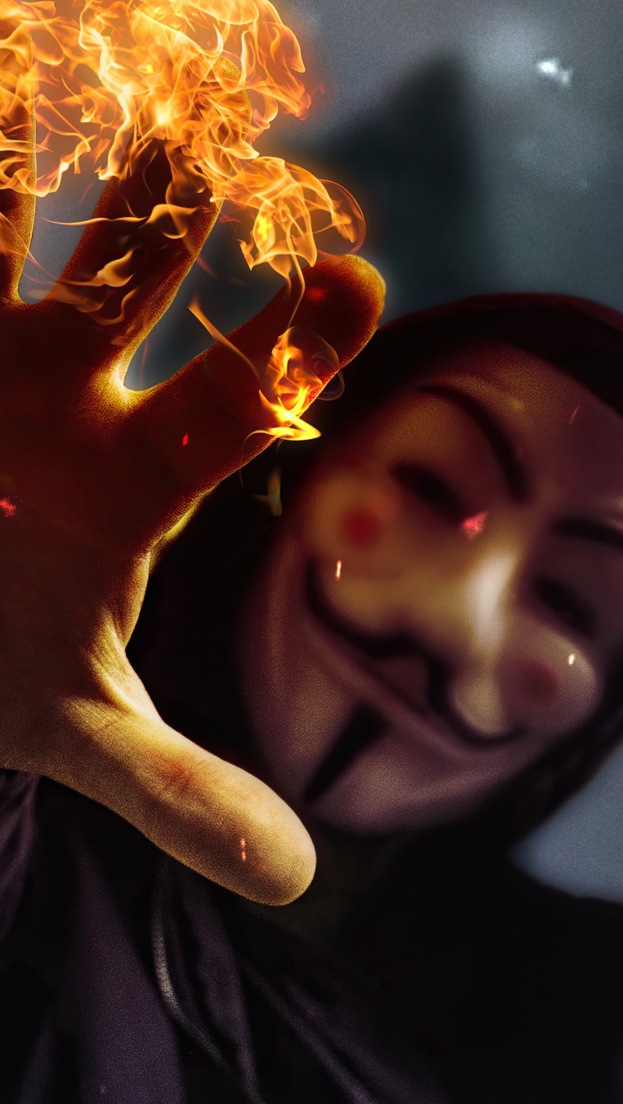 Wallpaper Anonymous mask with burning hand Vertical