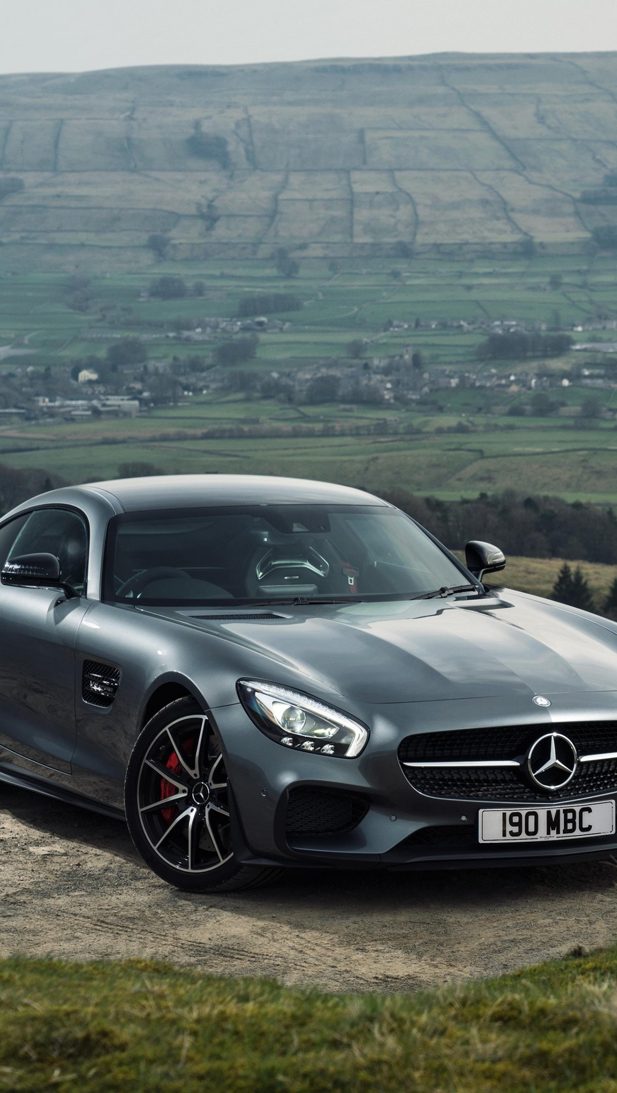 Wallpaper Mercedes AMG GT S gray in mountains Vertical