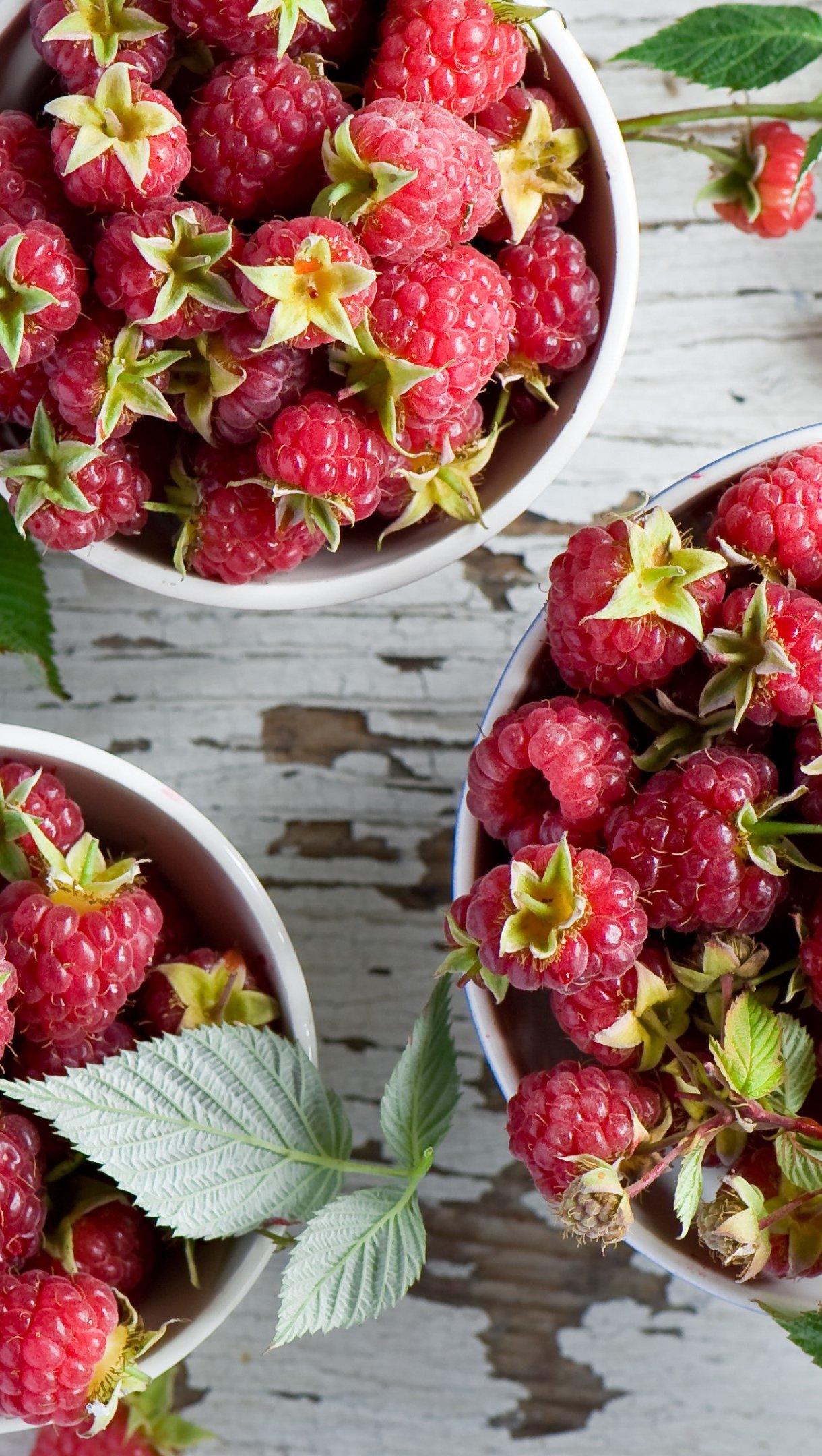 Wallpaper Table of raspberries Vertical
