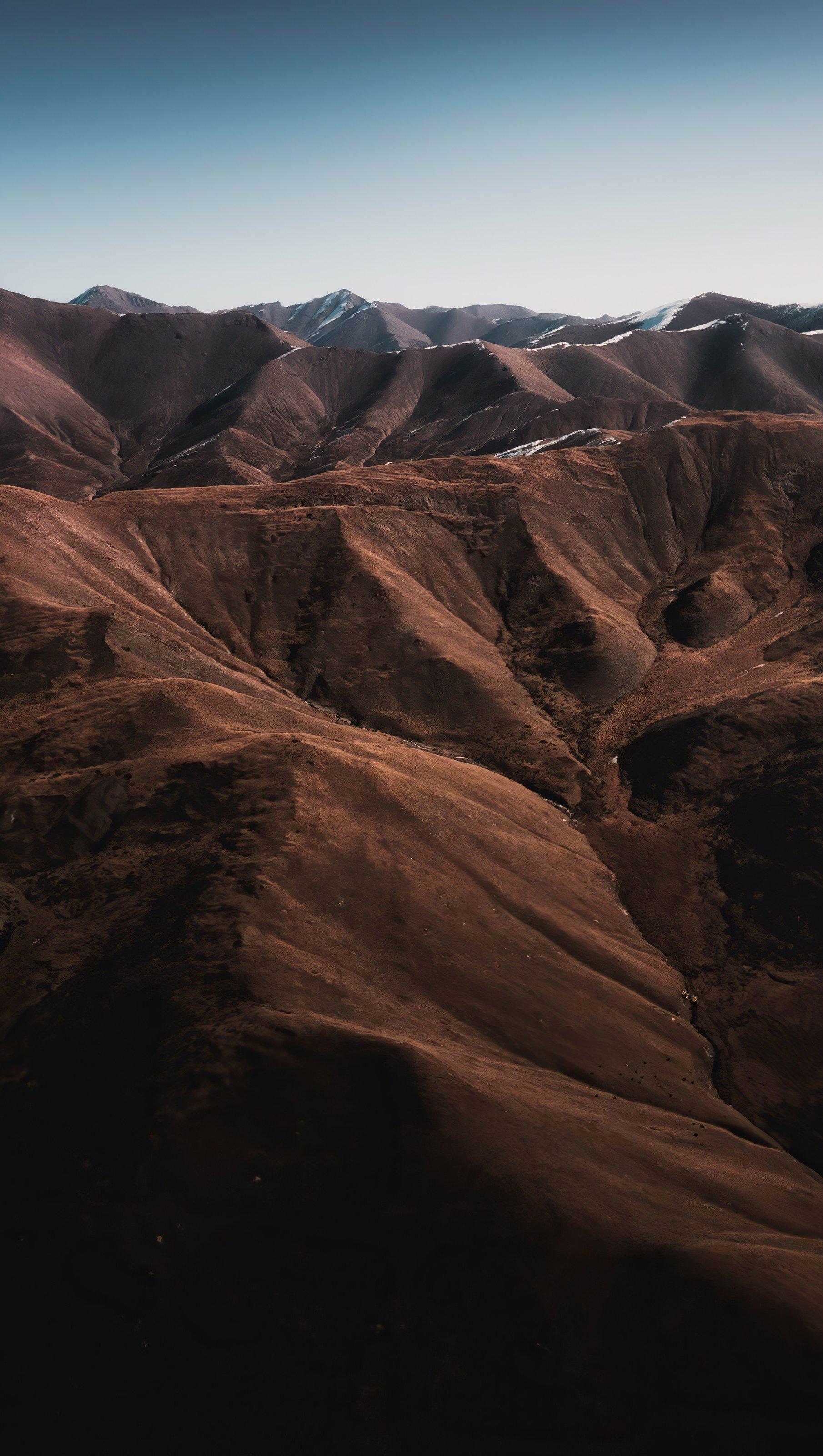 Fondos de pantalla Montañas agrupadas Vertical