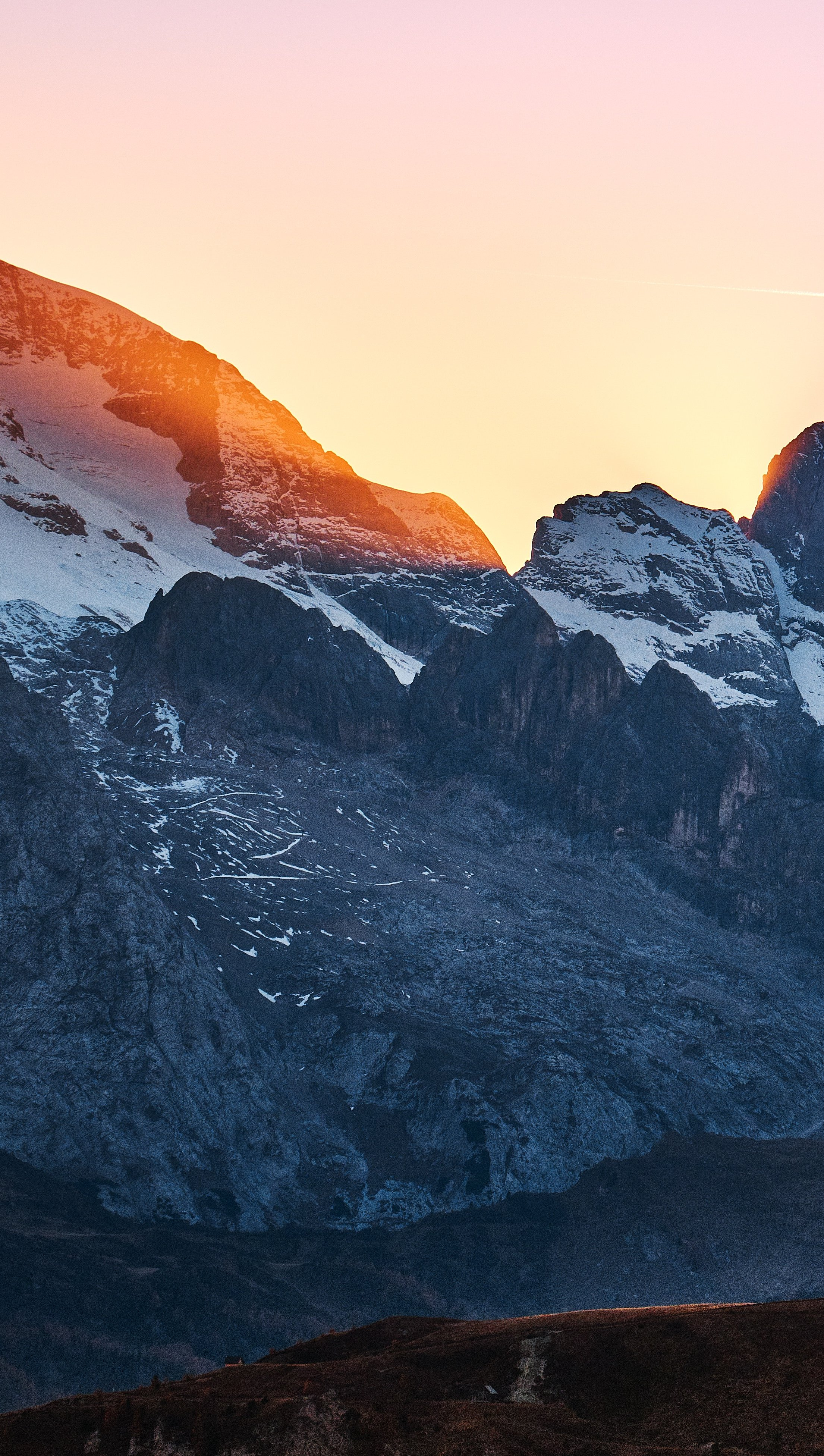 Wallpaper Snowy mountains in sunset Vertical