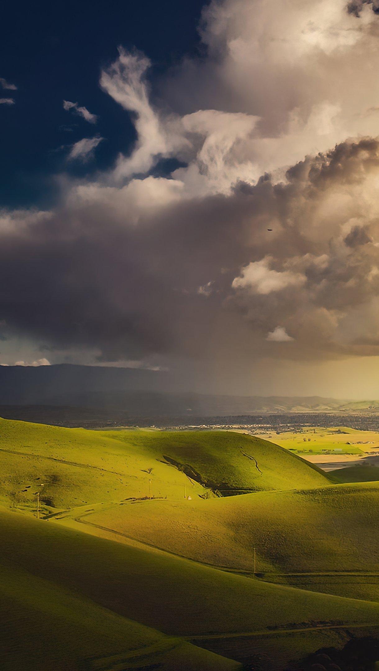 Fondos de pantalla Nubes sobre valle Vertical