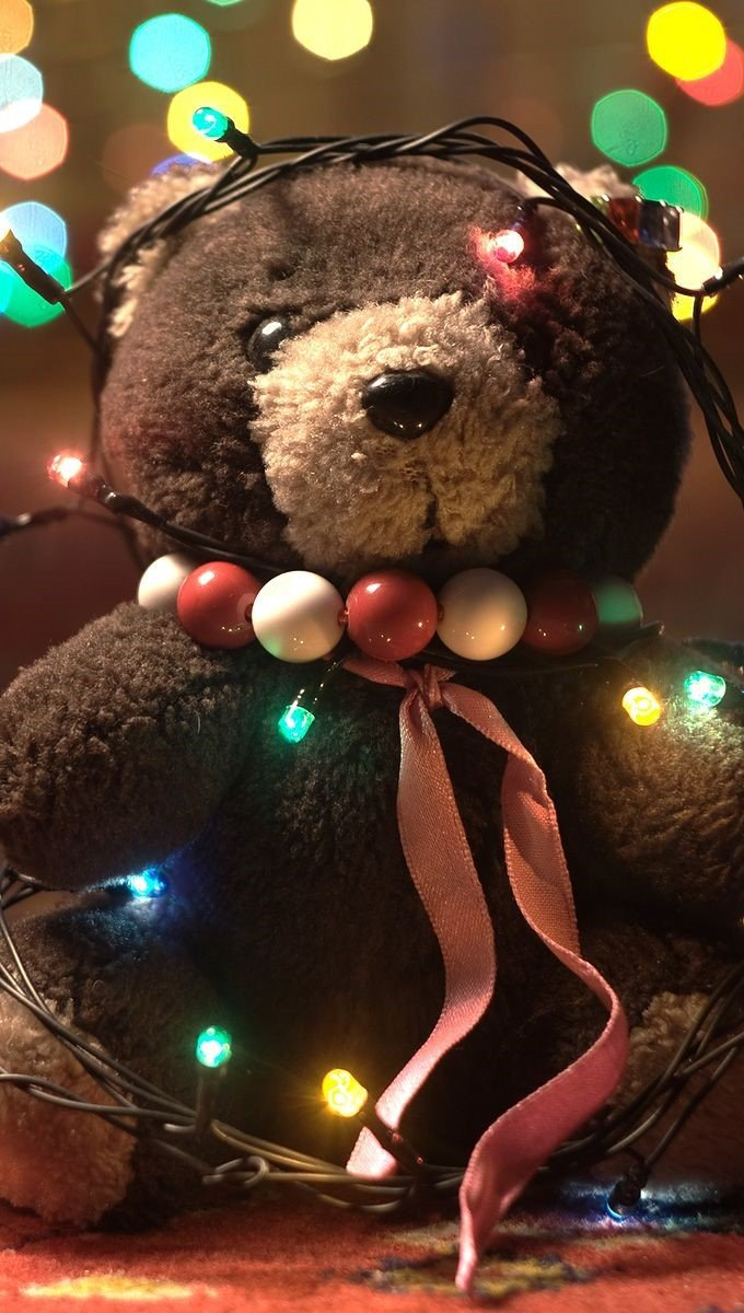 Fondos de pantalla Osito de peluche con luces de Navidad Vertical