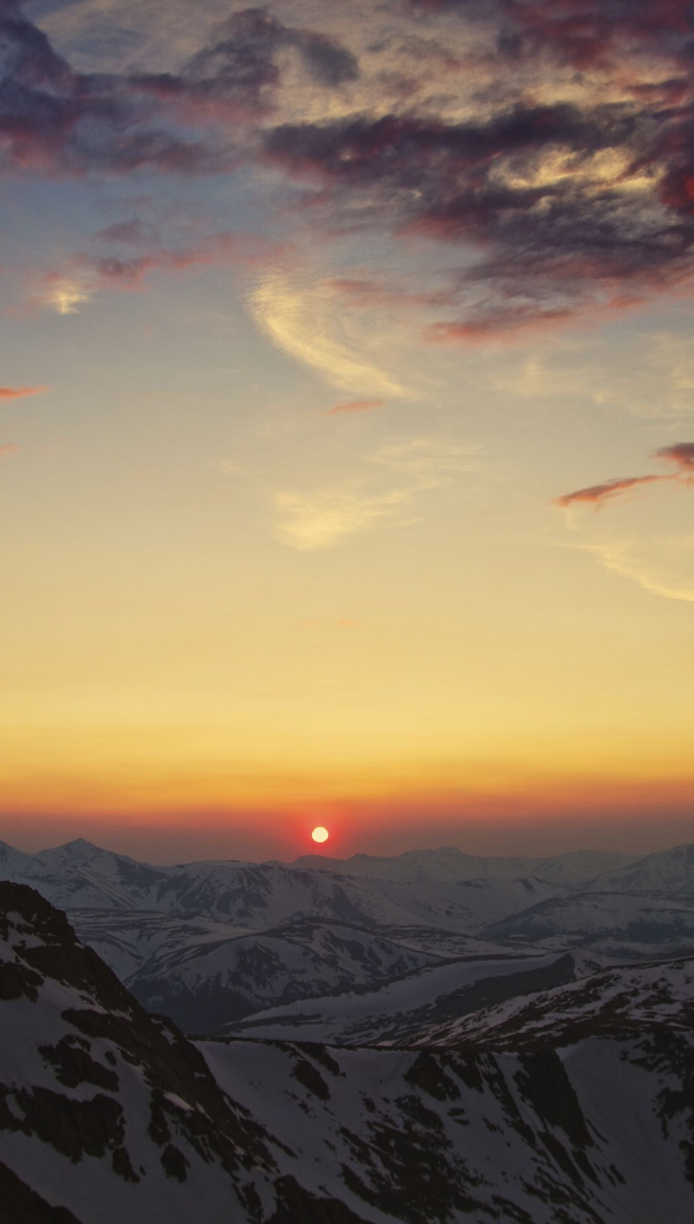 Wallpaper Aerial landscape of mountains at sunset Vertical
