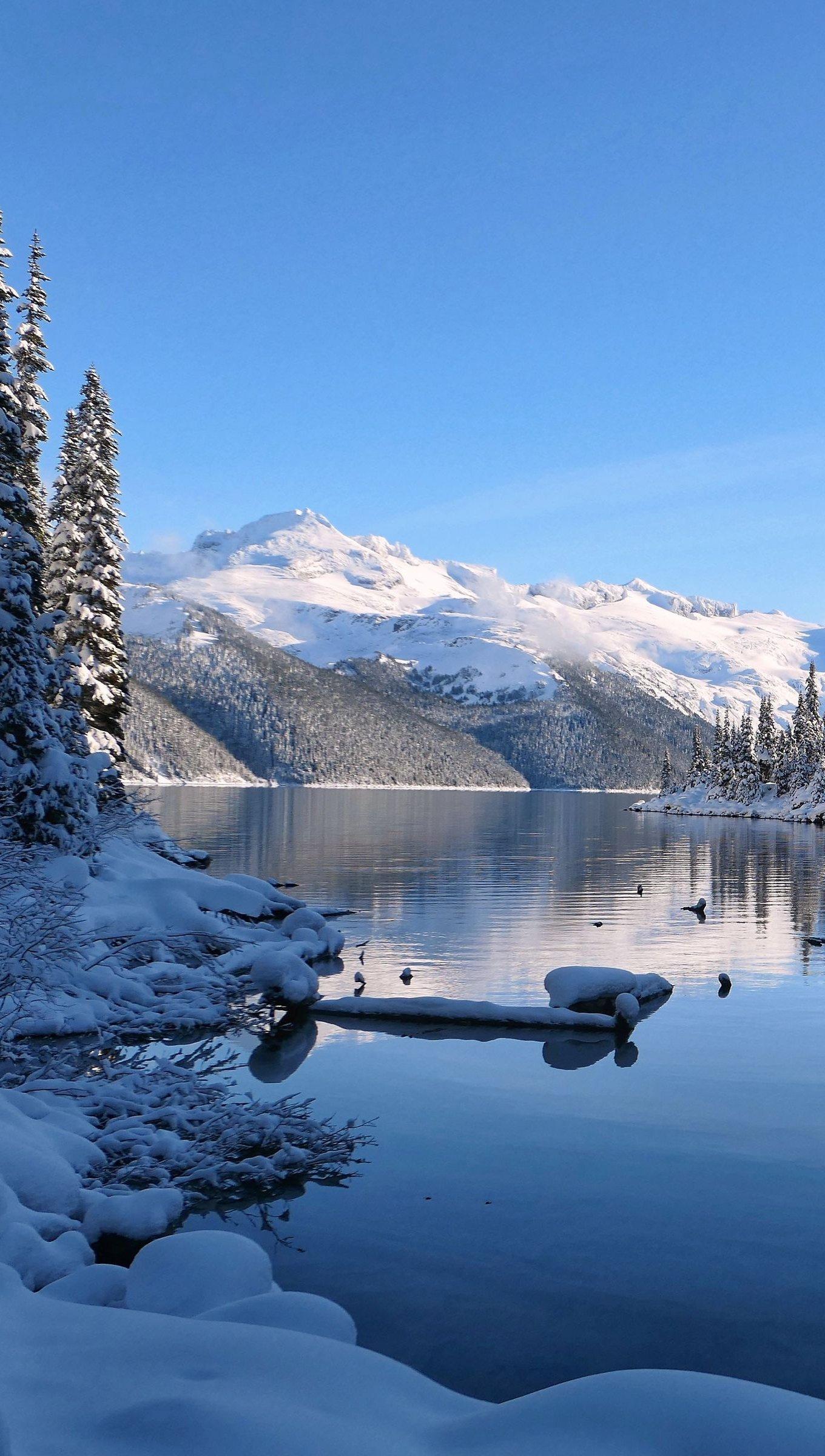 Fondos de pantalla Paisaje de lago en la nieve Vertical